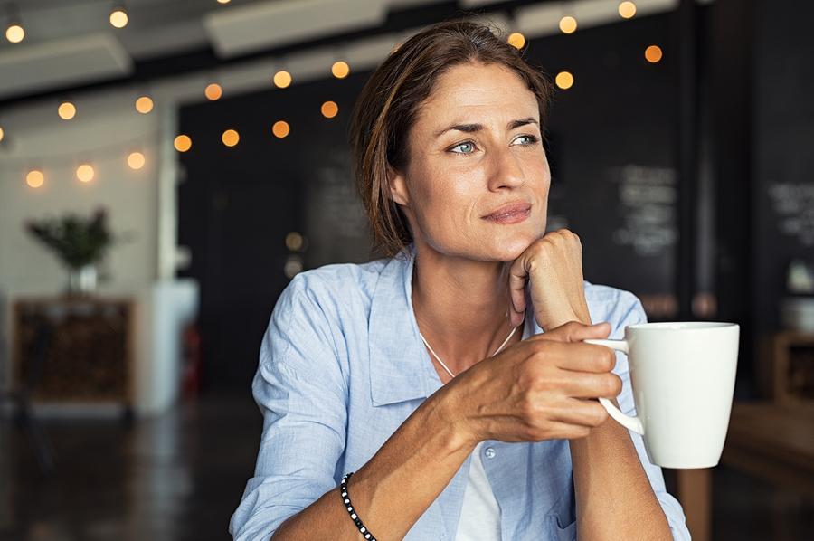 bigstock-Thoughtful-mature-woman-sittin-259489600.jpg