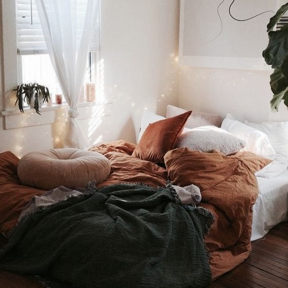 a-fall-colored-bedroom-done-in-dark-green-and-rust-and-diluted-with-creamy-and-white-for-a-fresh-touch.jpg