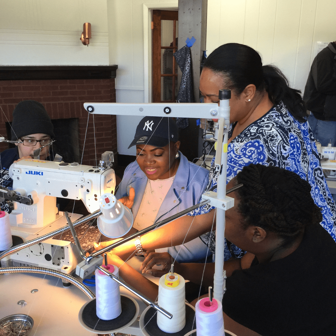 Seamstresses-being-trained-in-Newburgh-for-tech-startup-Zielwear.png
