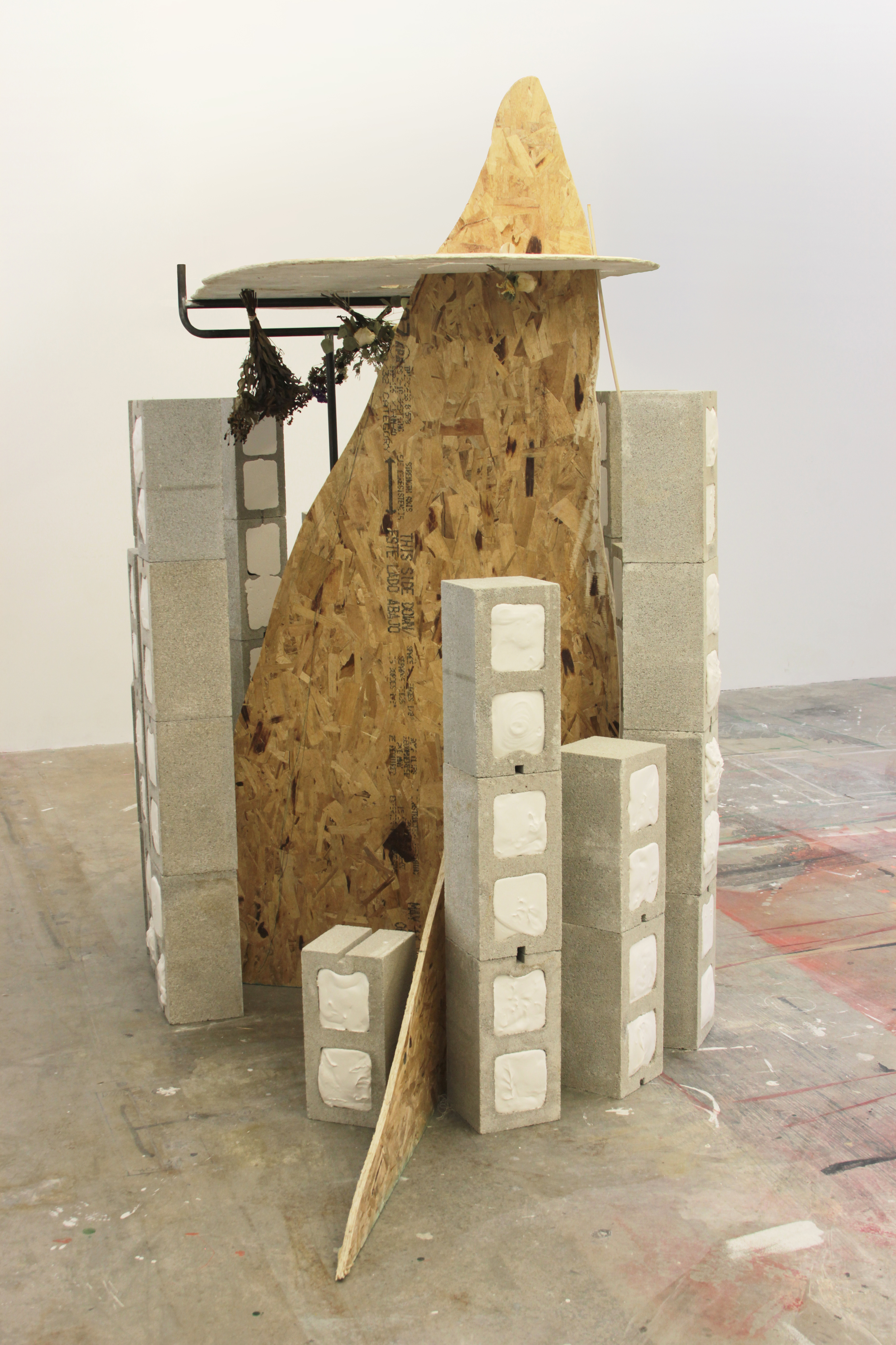 Father , 10' x 5' x9', particle board, metal, concrete masonry units, plaster