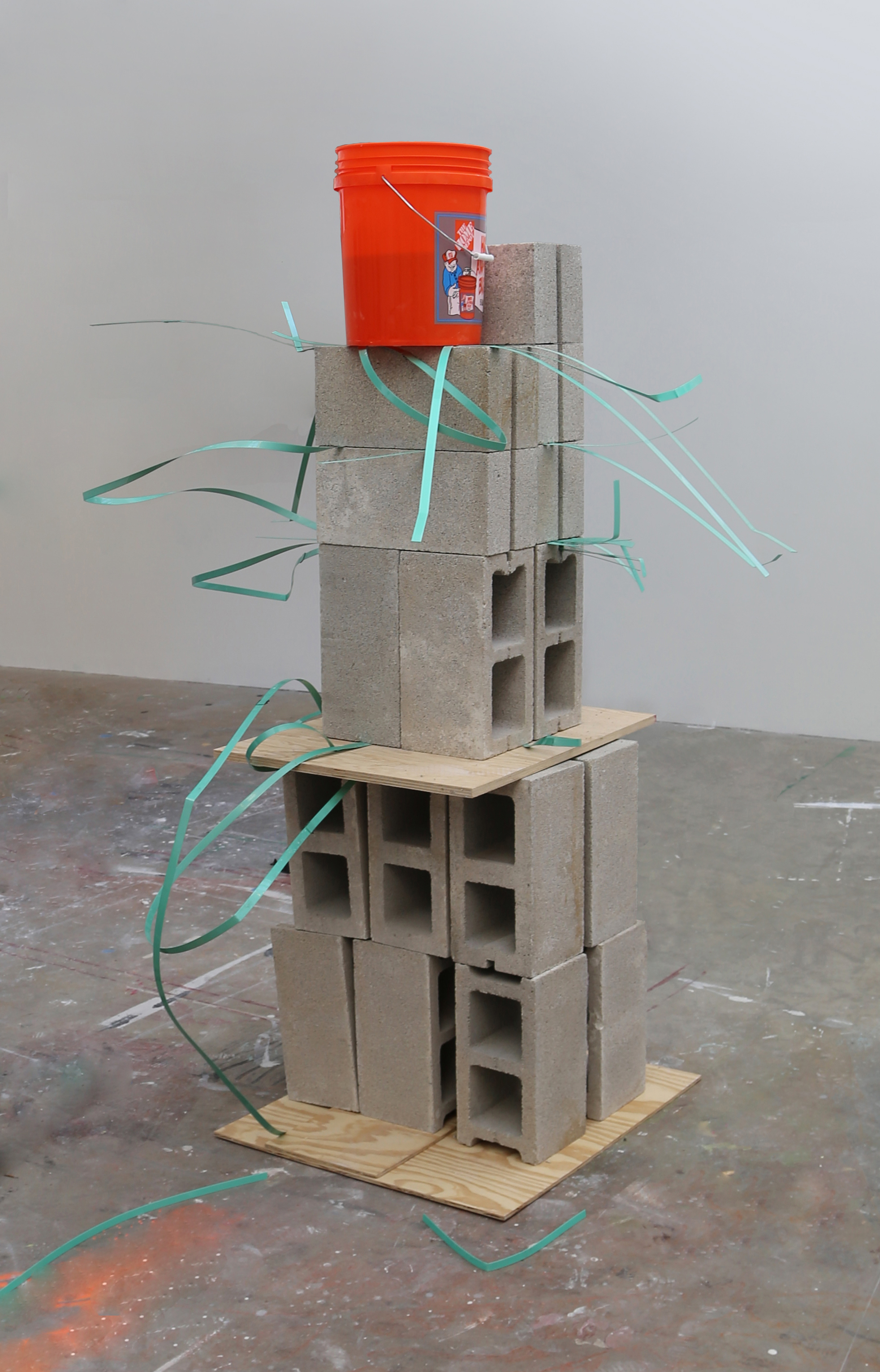 Untitled, 5' x 5' x 9', bucket, concrete masonry units, plywood, plastic palette straps
