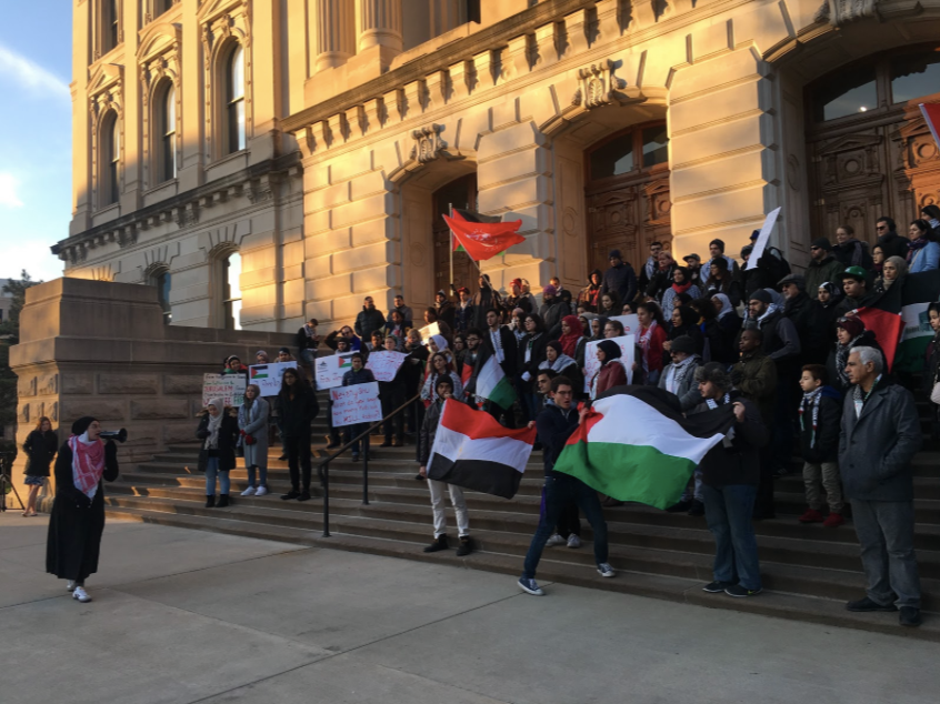Rally for Jerusalem at the Indiana Statehouse (2017).  Trump announced moving the U.S. embassy to Jerusalem, effectively legitimizing Israel's illegal occupation and colonization of Palestine. Thus, Muslim Youth Collective and other Indianapolis community members took to the streets to protect this destructive move. More than 60 Palestinian civilians were killed by Israel the day the embassy was transferred.