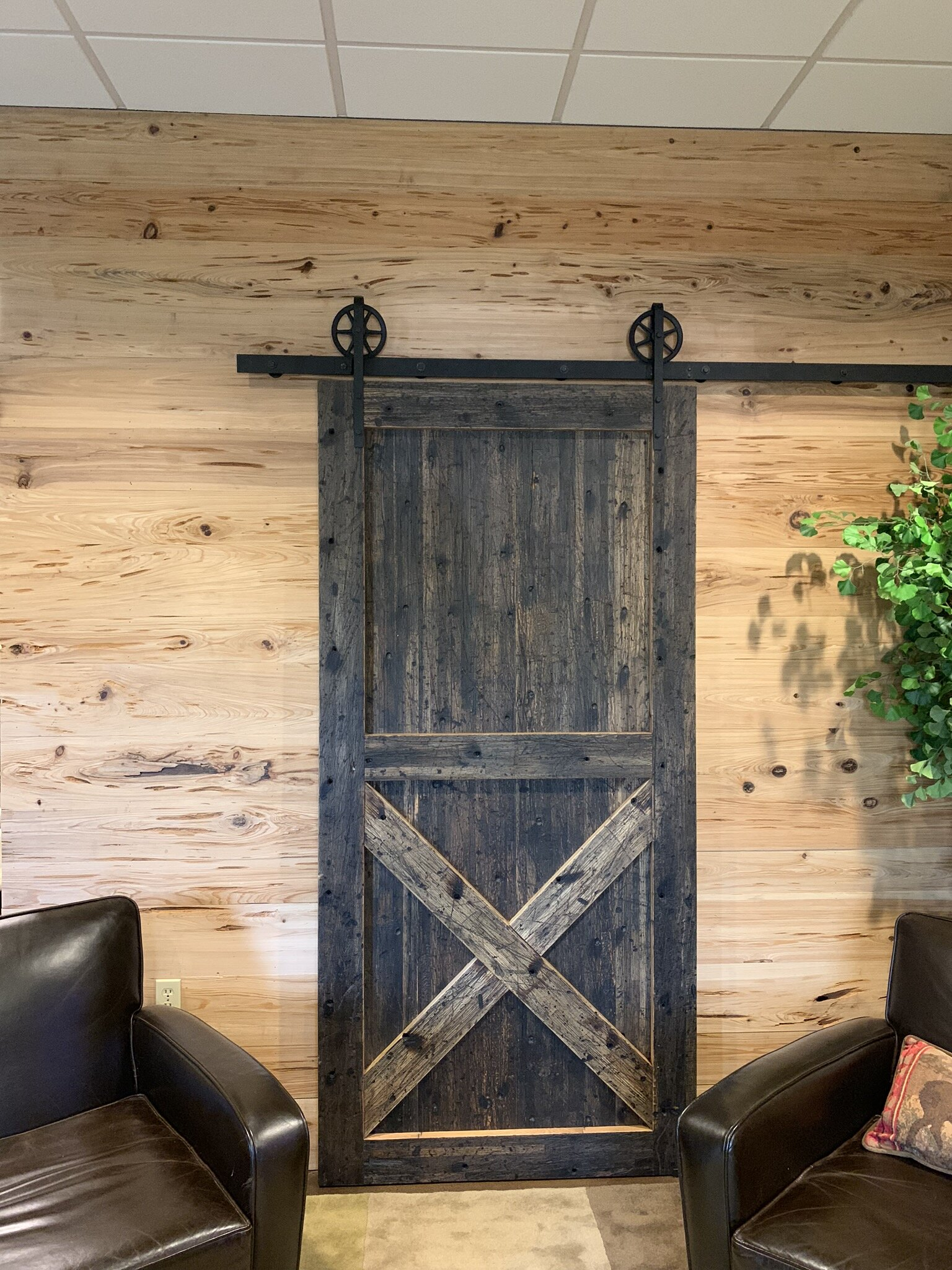 Copy of Pecky Cypress Wall and Custom Sliding Door by Good Wood Nashville