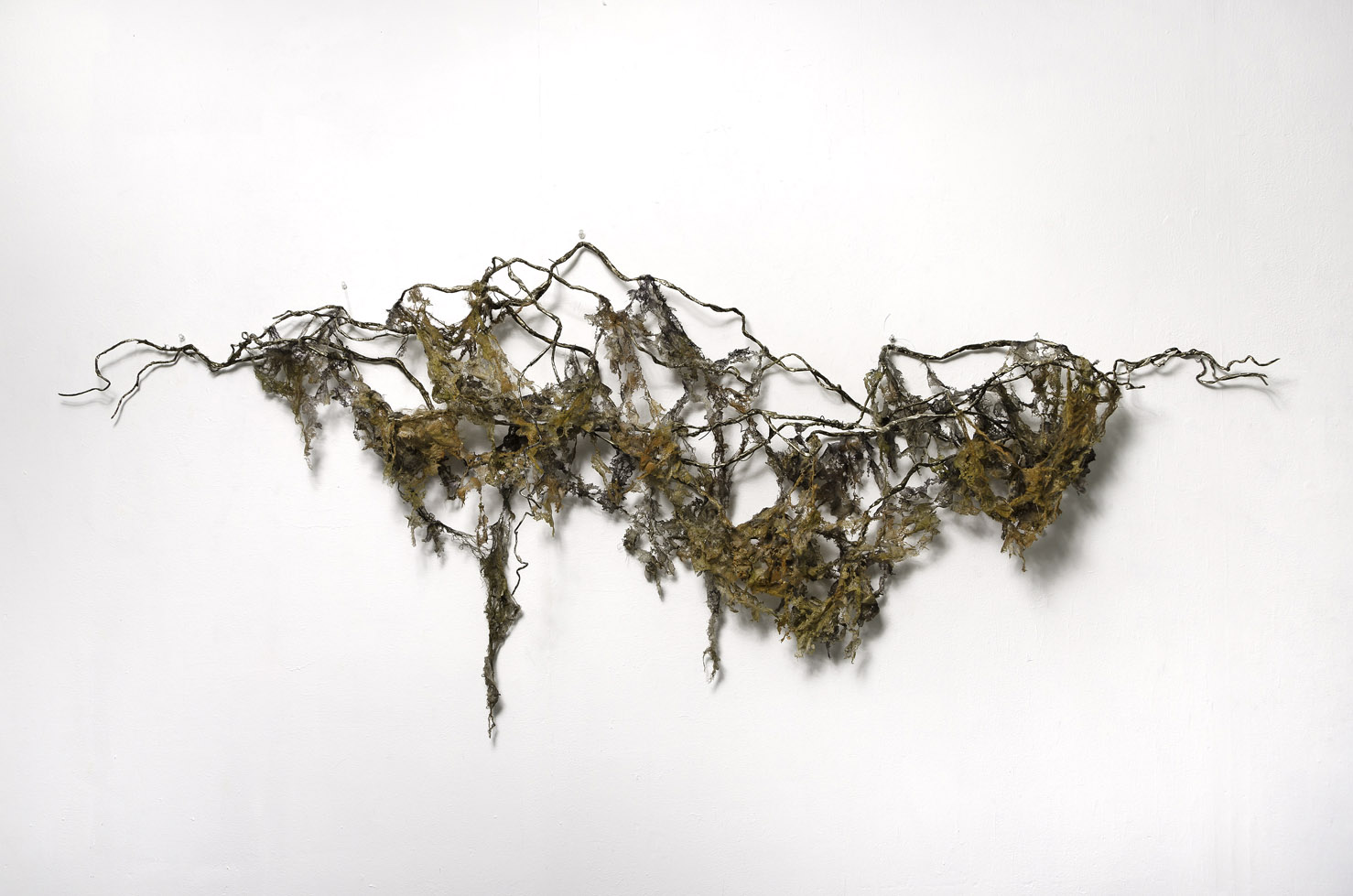 """Unruly Findings 3,     2018  Wire, melted pellon, cheesecloth, tape, spray paint, ink. 35"""" x 84"""" x 12"""""""