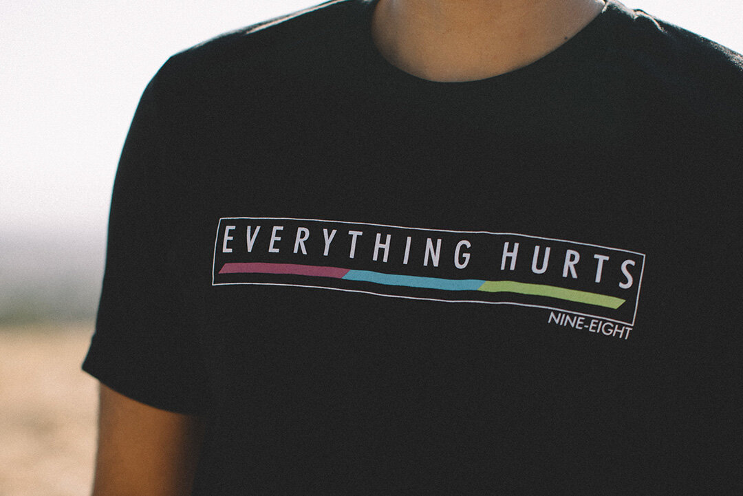 EVERYTHING HURTS STAPLE TEE