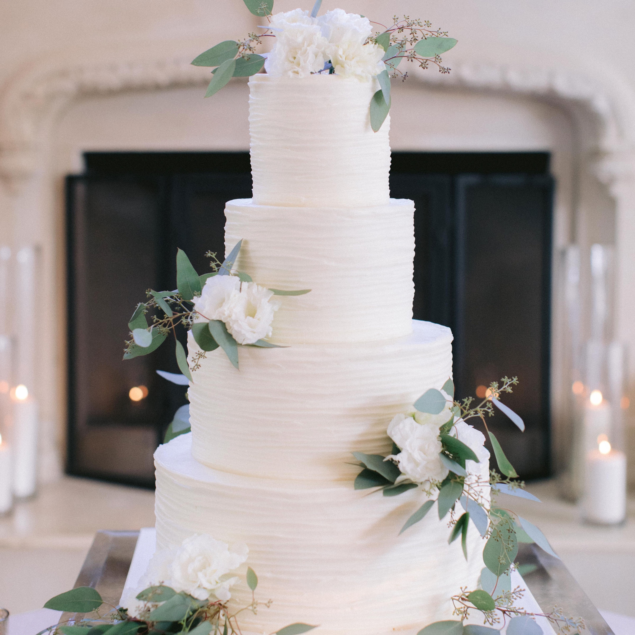 I personally think we had the BEST wedding cake ever! It was simple, but elegant. It consisted of three flavors, which included my all time favorite- coconut!!  The Butter End Cakery  sure out did themselves- thank you!!