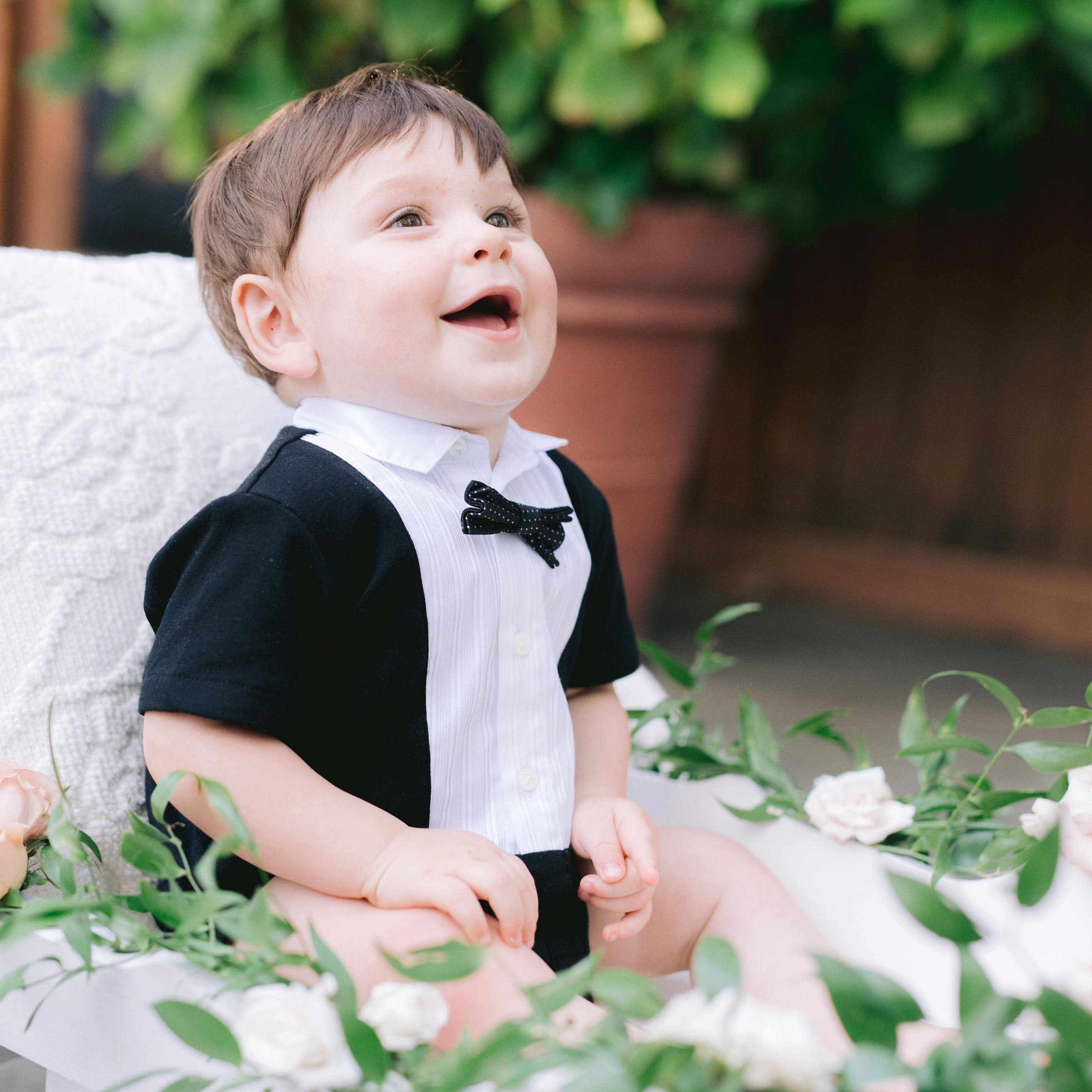 My cousin Adam pulled Chase down the aisle in this beautiful white wagon. Chase was all smiles in his D&G playsuit for the whole wedding.