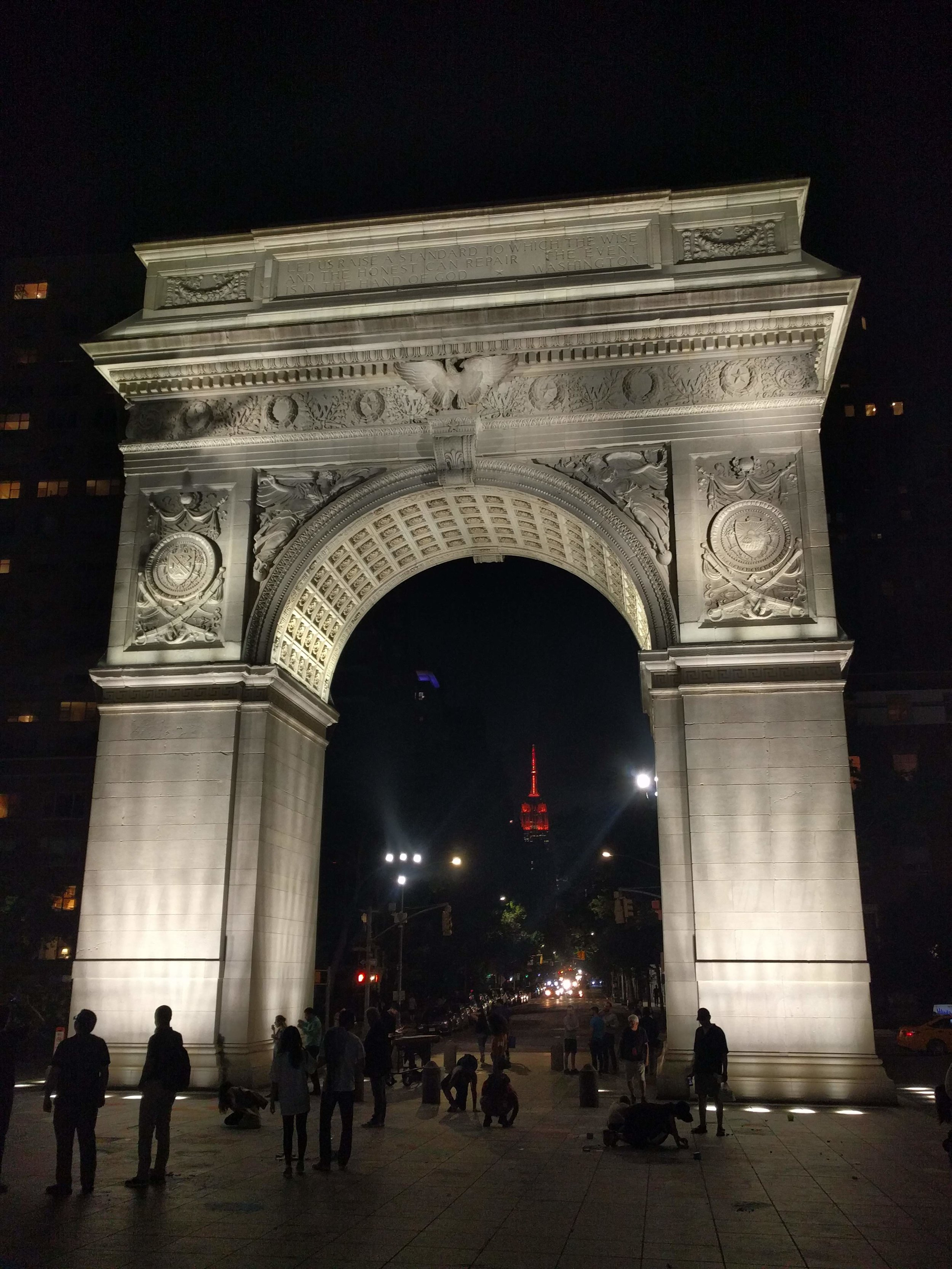 The Empire State seen through the Washington Square Arch in Washington Square Park outside of NYU; New York City. Summer 2018.