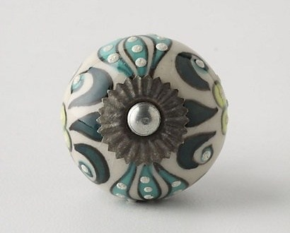 When I was down in Palm Springs I picked up some lovely knobs  at  Anthropologie . They have the most amazing hardware that I wrote an entire post on it.  See here