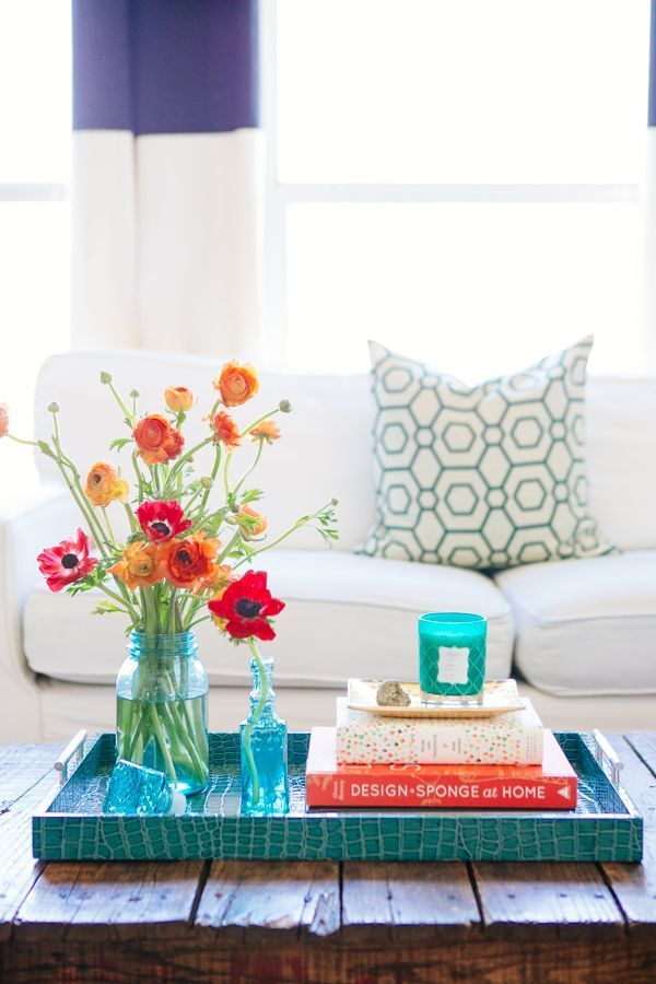 3. Fresh flowers are and easy way to bring a pop of colour into any room.   Love the bright colour faux alligator tray!