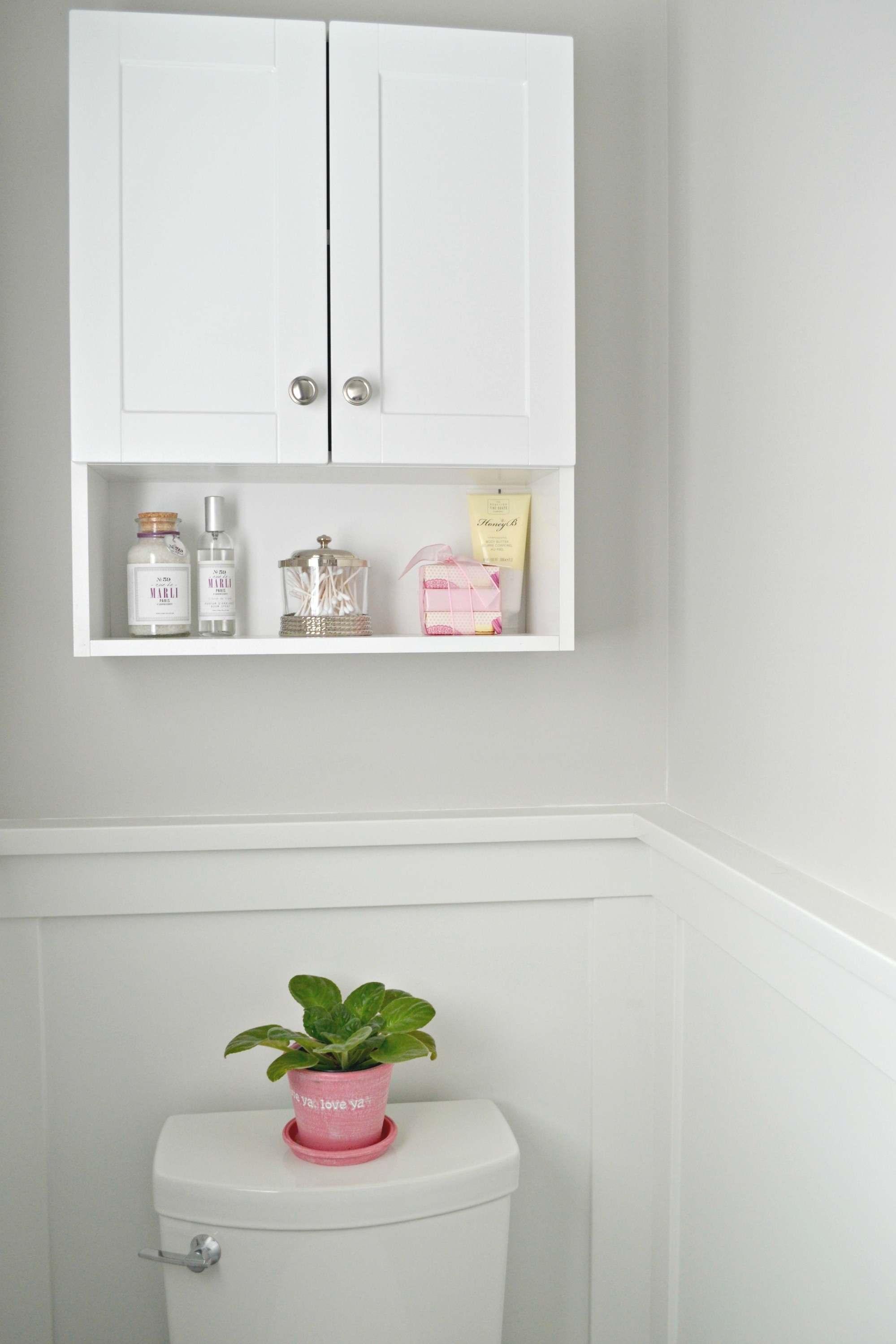 I did add a cabinet above the toilet for some storage for guests and extra toiletries.