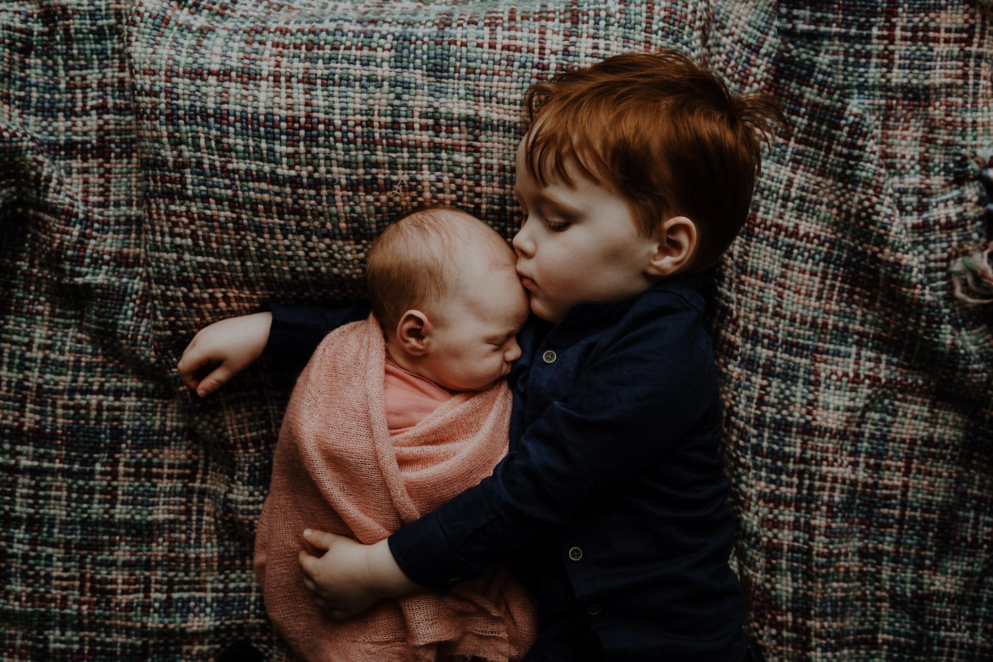 brother-kisses-newborn-baby-girl-photoshoot-belfast