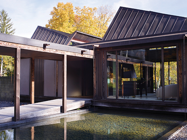 At the Natori Residence in Pound Ridge, designed by Calvin Tsao and Zack McKown, the garden's water element forms a threshold to the formal entry. Simon Upton Photo