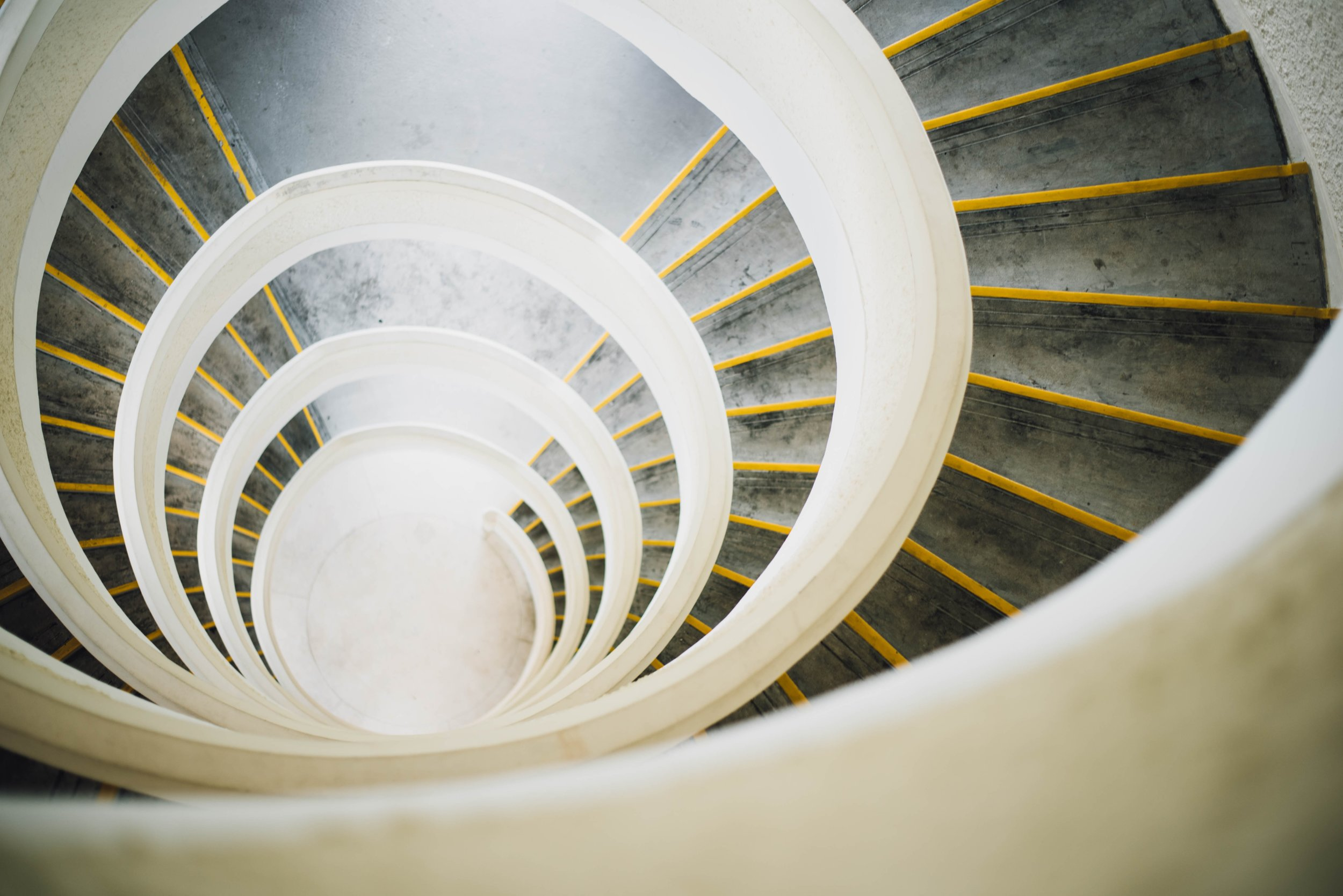 full-circle-winding-staircase-chuttersnap-179220-unsplash.jpg