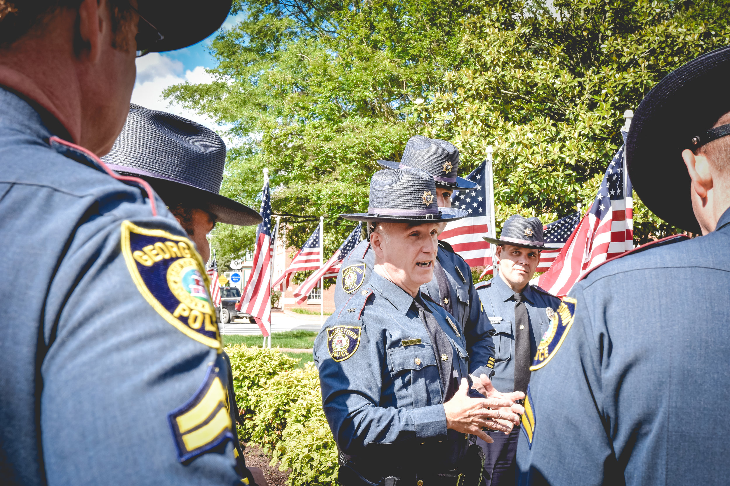 """- """"The Guardians of Georgetown take great pride in providing contemporary, ethical, and transparent police services to all of our residents. We are committed to listening to you and working to collaboratively solving issues. I have said a number of times, the police cannot go it alone, we need the support of you, our community. And so, it is our promise to continually strive to provide a safe and secure environment so that we may all enjoy the rich heritage of our community, Georgetown.""""-R. L. Hughes, Chief of Police"""