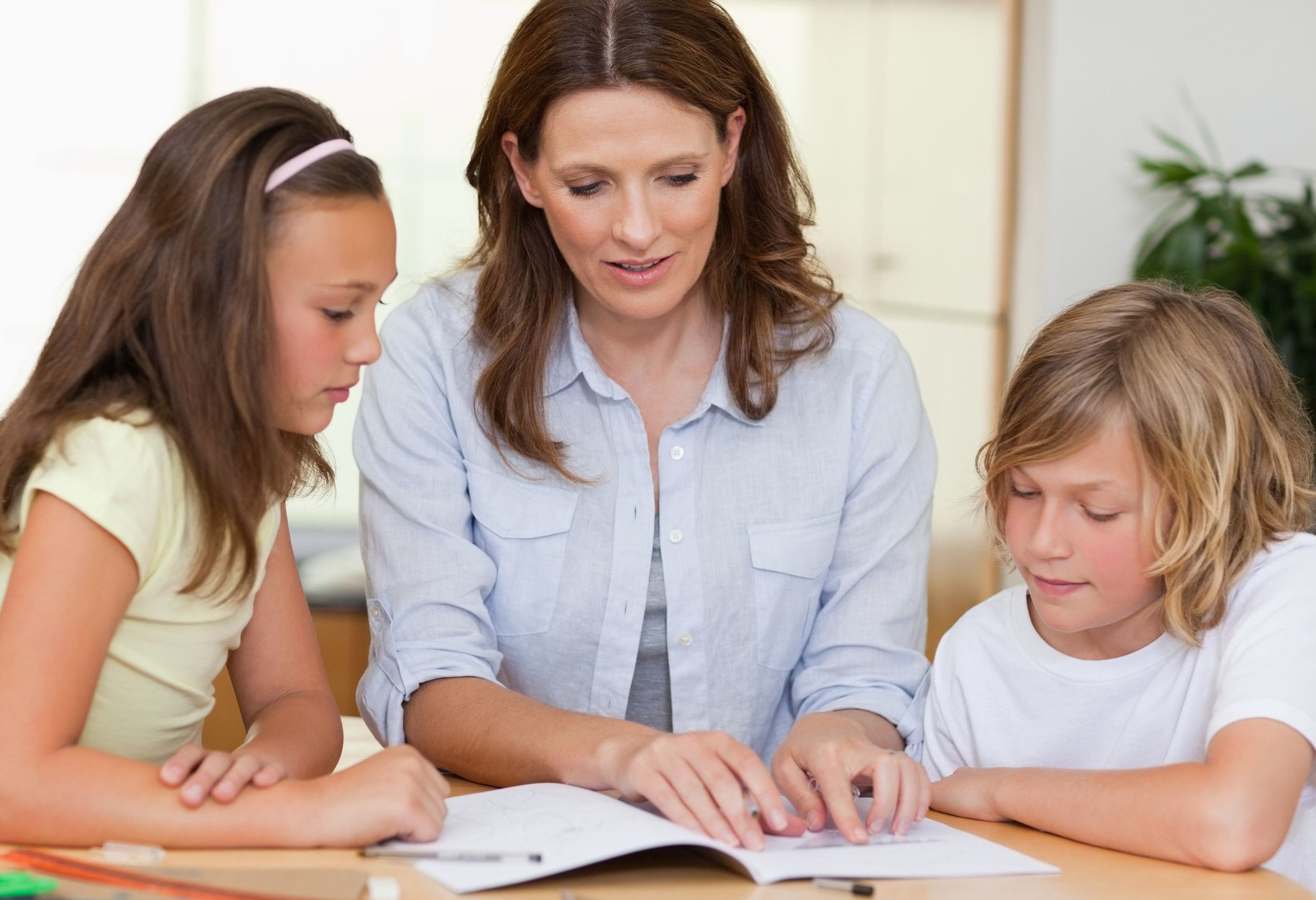 teacher with two students jpg cropped.jpg