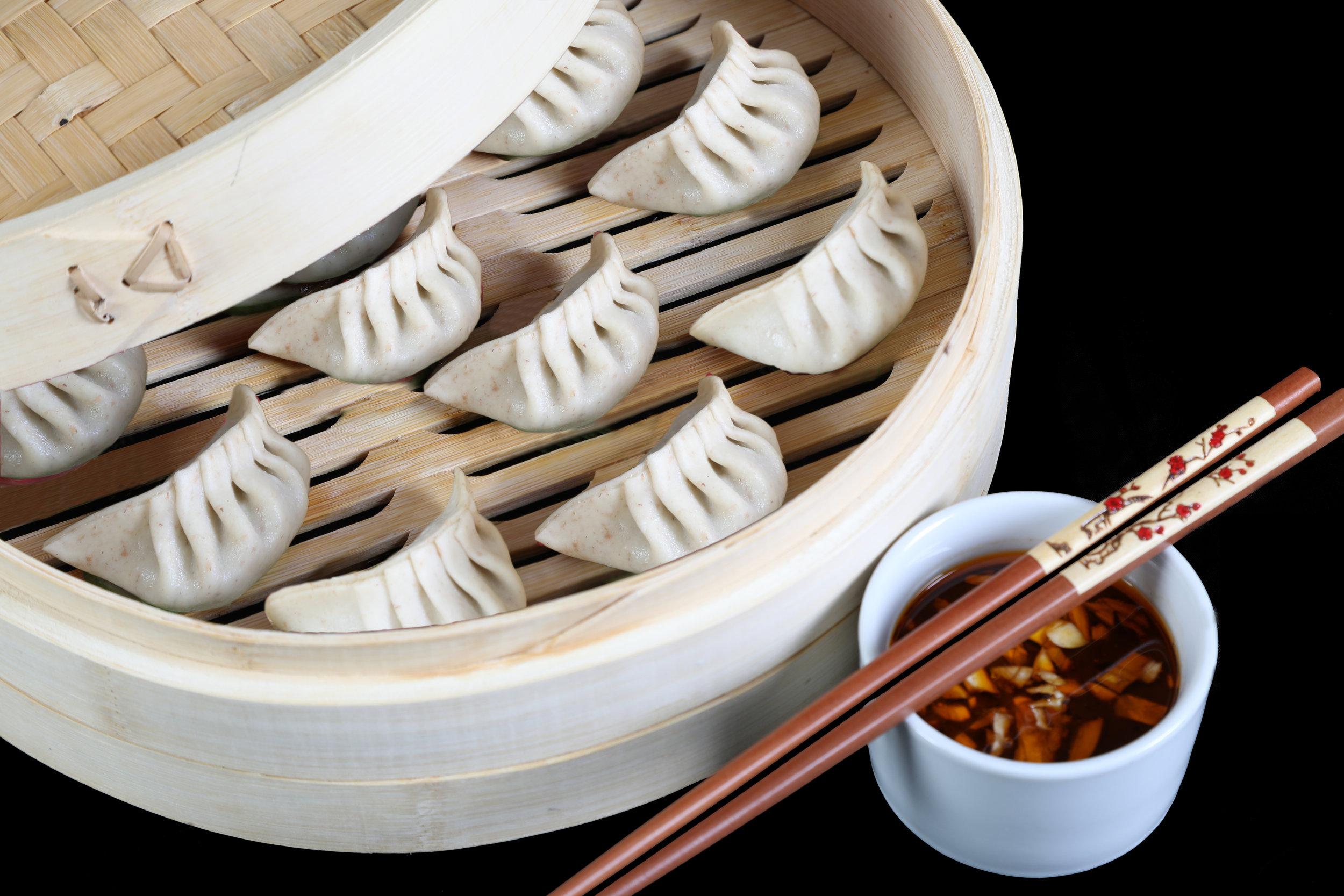 Schwein & Chinakohl Dim Sum - Dieses klassische Schweinefleisch Dim Sum bringt Ihnen die authentische Küche Chinas.