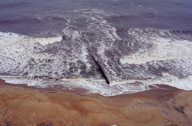 Rip current moving offshore at groin at Cape Hatteras, North Carolina.