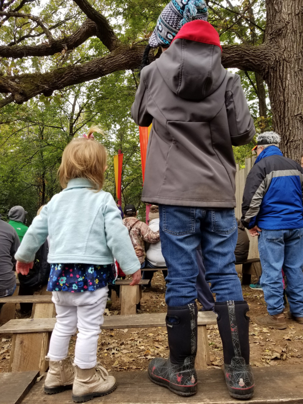 Our little ones taking in a show at the Renaissance Festival.
