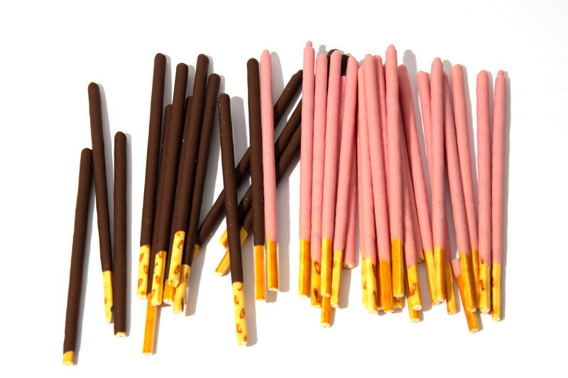Canva - Pocky candy background.Box for cookies with bright flogging.Japan sweets. Bright white background.jpg
