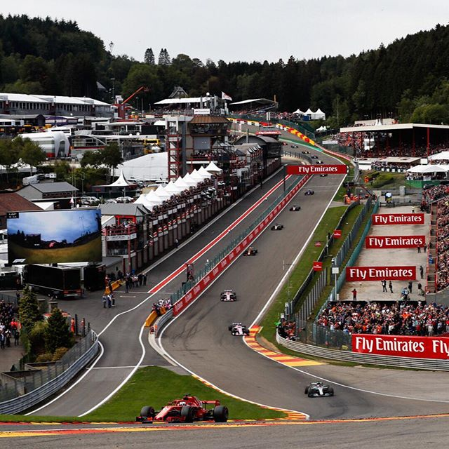 "What's unique about the #BelgianGP? Eau Rouge – Raidillon. This turn is a challenge for drivers to navigate, and it's a beauty for the viewer to watch. Fernando Alonso explained in an F1 conference, ""You come into the corner downhill, have a sudden change at the bottom, and then go very steep uphill. From the cockpit, you cannot see the exit, and as you come over the crest, you don't know where you will land."" It is our favorite place to perch. ⠀⠀⠀⠀⠀⠀⠀⠀⠀ #WeHeartF1 #TheRevJournal #spafrancorchamps #formulaone #circuit #grandprix #raceweekend #f12019 #f1fans #eaurouge #raidillon #f1weekend #racetrack #motorsport #grandstand #viewfromhere #letsgo #f1"