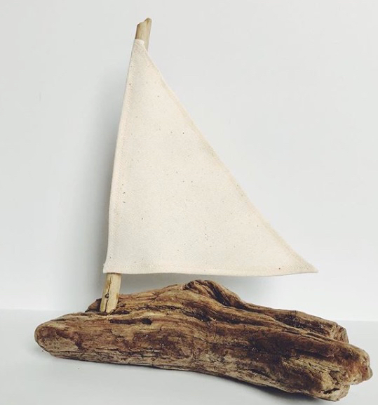 Handcrafted Driftwood Sailboat decor for accentuating a side table or shelf.