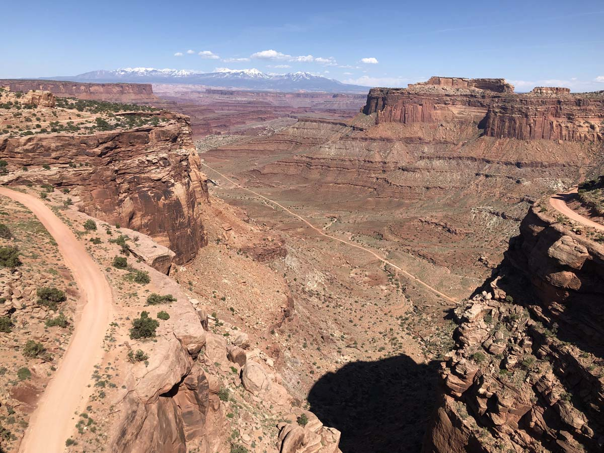 View from the top of the canyon with the Shafer Trail far below and a portion of the road leading up to exit at Canyonlands NP.
