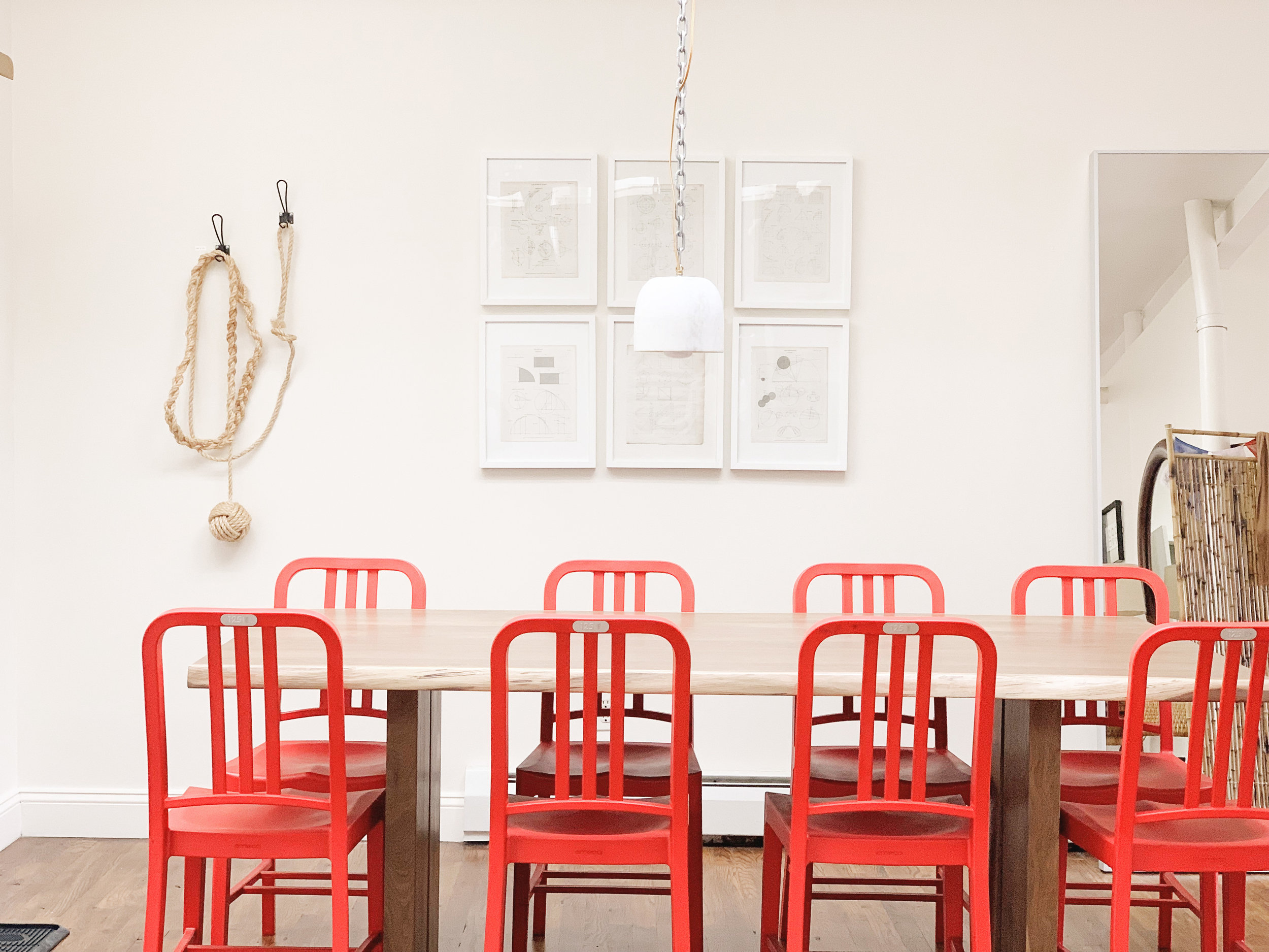 Common Dining Room.  Recycled Emeco Chairs, for Coke's 125th Anniversary. Rope Knot and Marble Pendant Lamp my own.