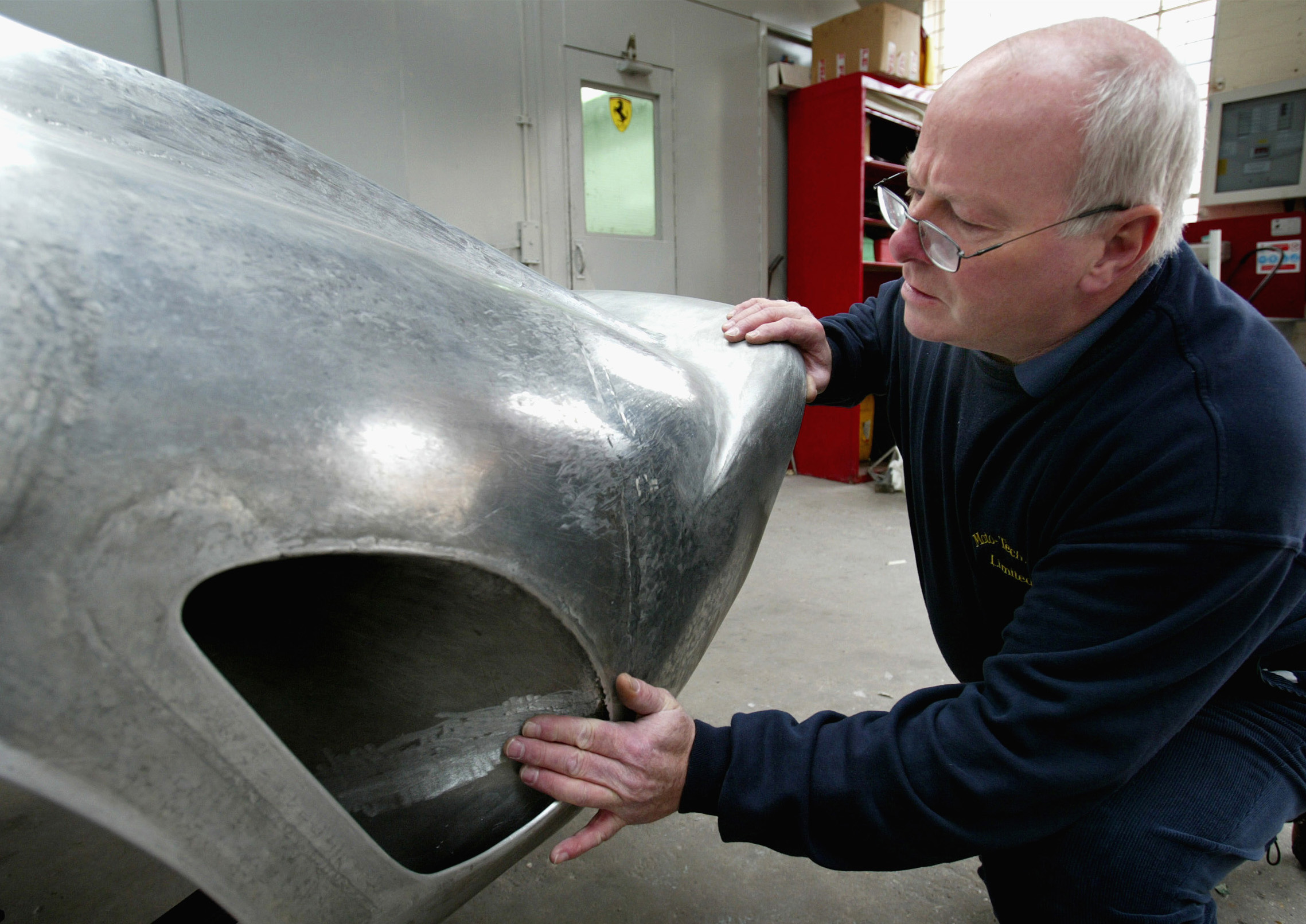 Kevin O'Rourke quality controlling the tail section repair on the Ferrari 250 GTO