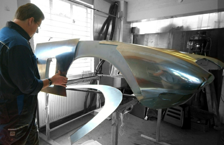 An Iso Grifo front wing being remade in mild steel by a Moto Technique artisan panel beater. The no longer available panel was made to absolute millimetre perfection as the picture below clearly shows.