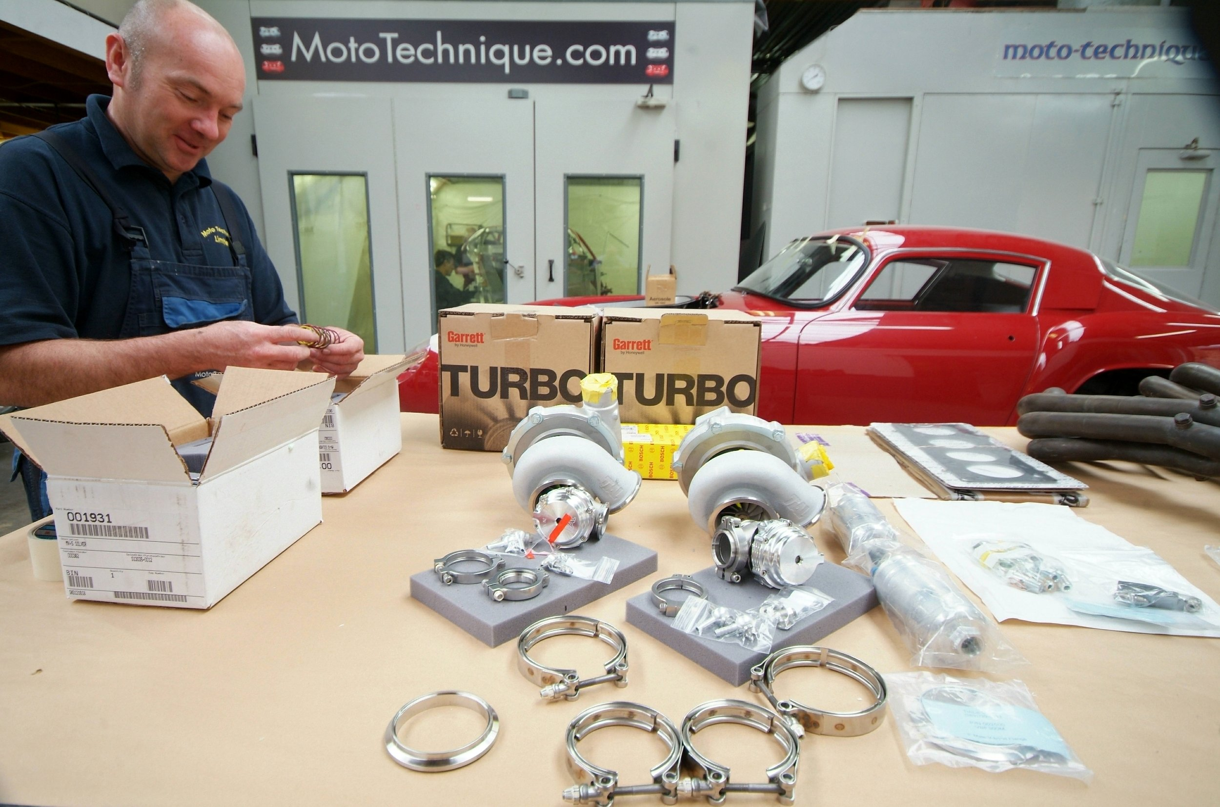 Turbo chargers being unpacked and inspected prior to fitting onto an upgrade project.