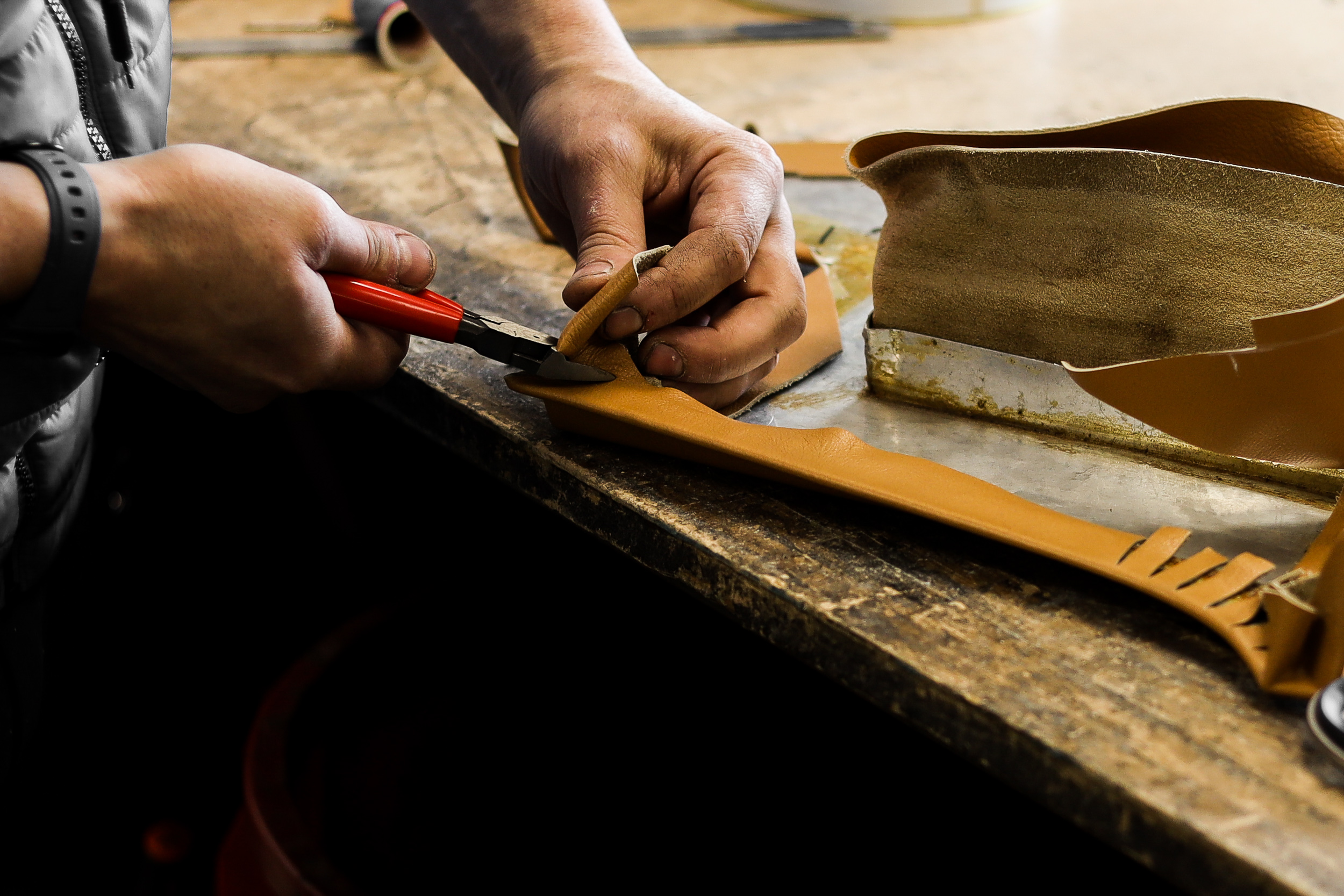 The experienced hands of a true artisan craftsman. Photo by   O'ROURKE COACHTRIMMERS