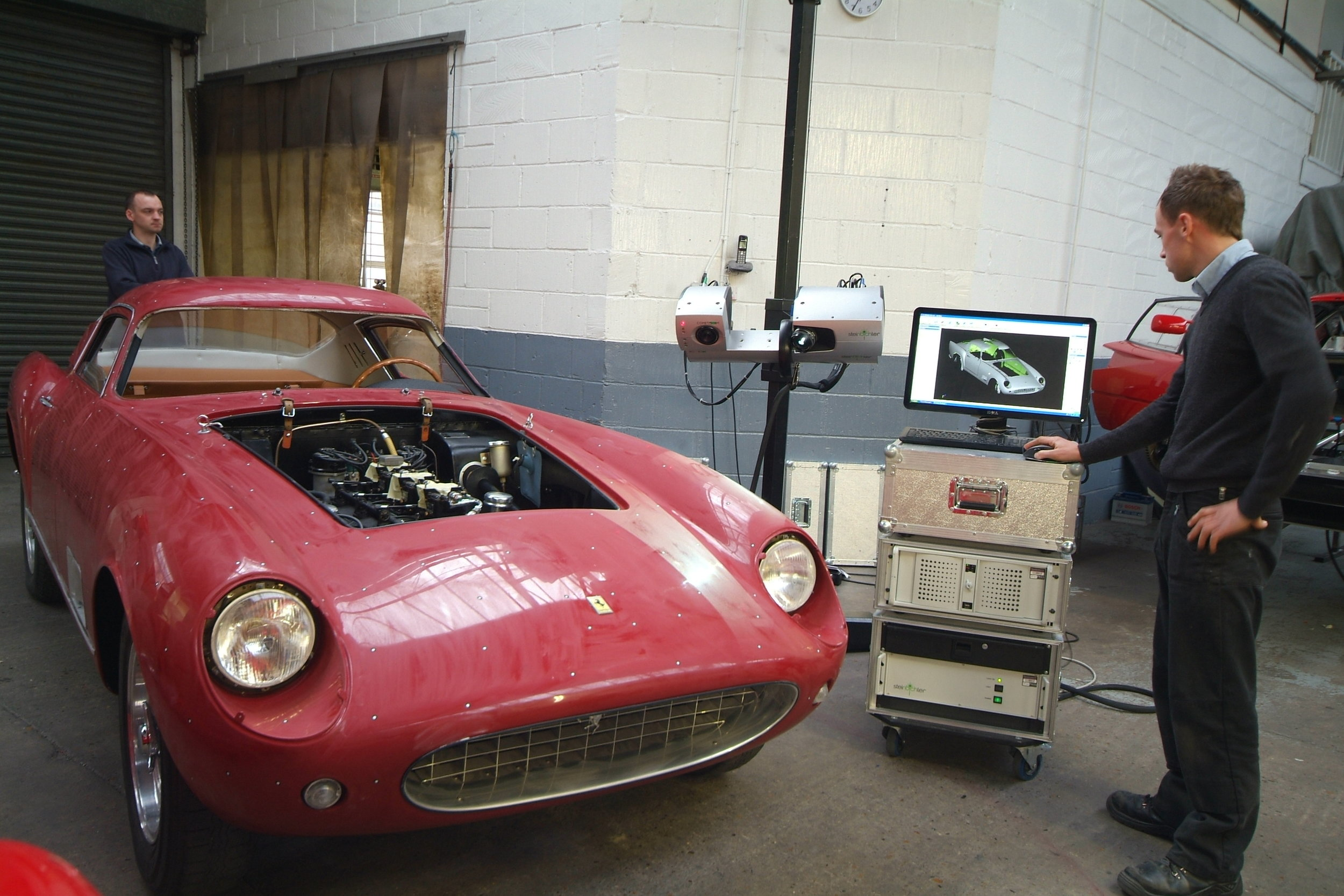 The bodywork of a Ferrari 250 TDF being completely scanned in 3D to millimetre precision, so that a wooden buck can be manufactured from the results. Utilising the very latest technology, so that we can produce the most accurate panels in the traditional way.
