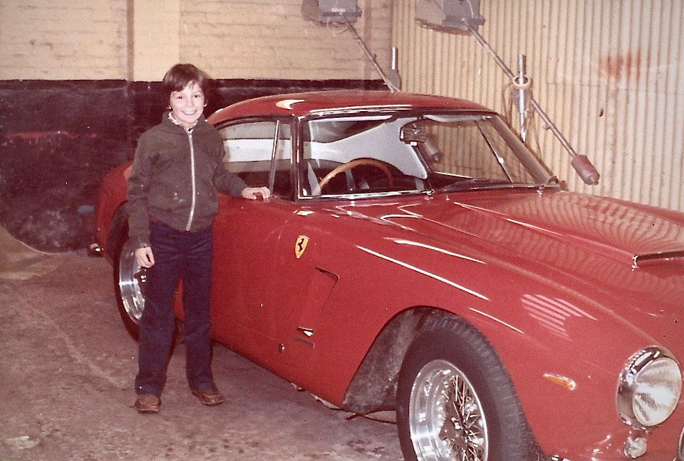 "A young ""Rorky"" O'Rourke next to a Ferrari 250GT SWB in his dads workshop in the early 1980's."