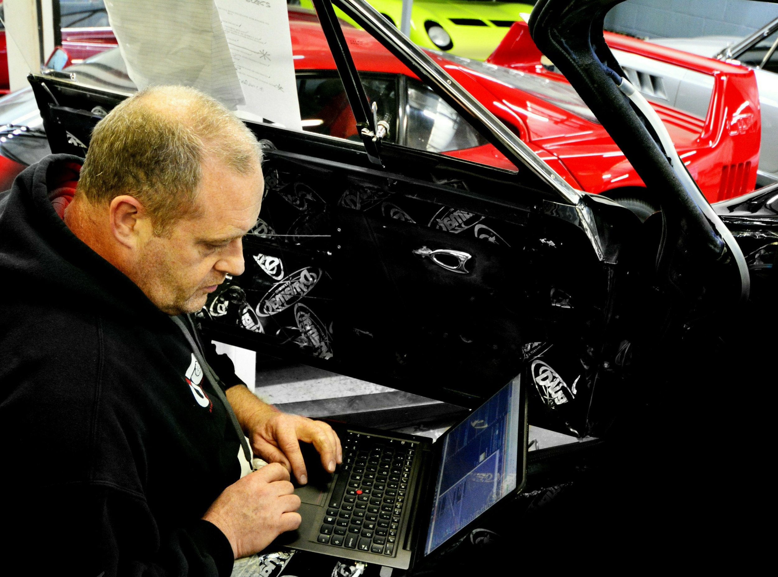 A software engineer fine tuning MoTec engine management software on a Ferrari V8 engine which has been upgraded in house by Moto Technique to produce 400bhp. The results is a smooth power delivery in all conditions which is totally reliable.
