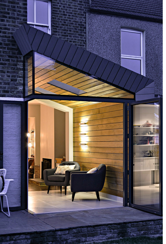 03-whatman-road-victorian-house-extension-architecture-night-lights-oak-cladding-bi-fold-doors-south-east-london-uk-rider-stirland-architects.jpg