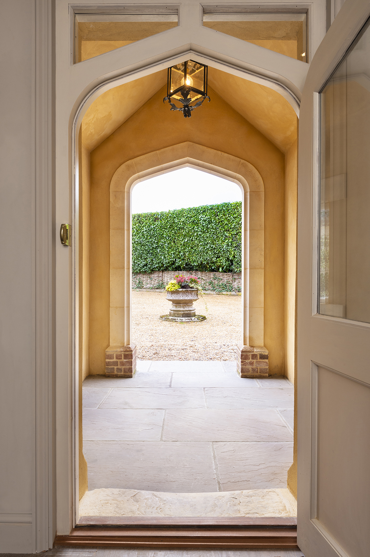 02-elsted-porch-rectory-house-extension-handmade-bricks-bath-stone-arch-stonemasonry-architecture-chichester-west-sussex-south-downs-national-park-uk-rider-stirland-architects.jpg.jpg