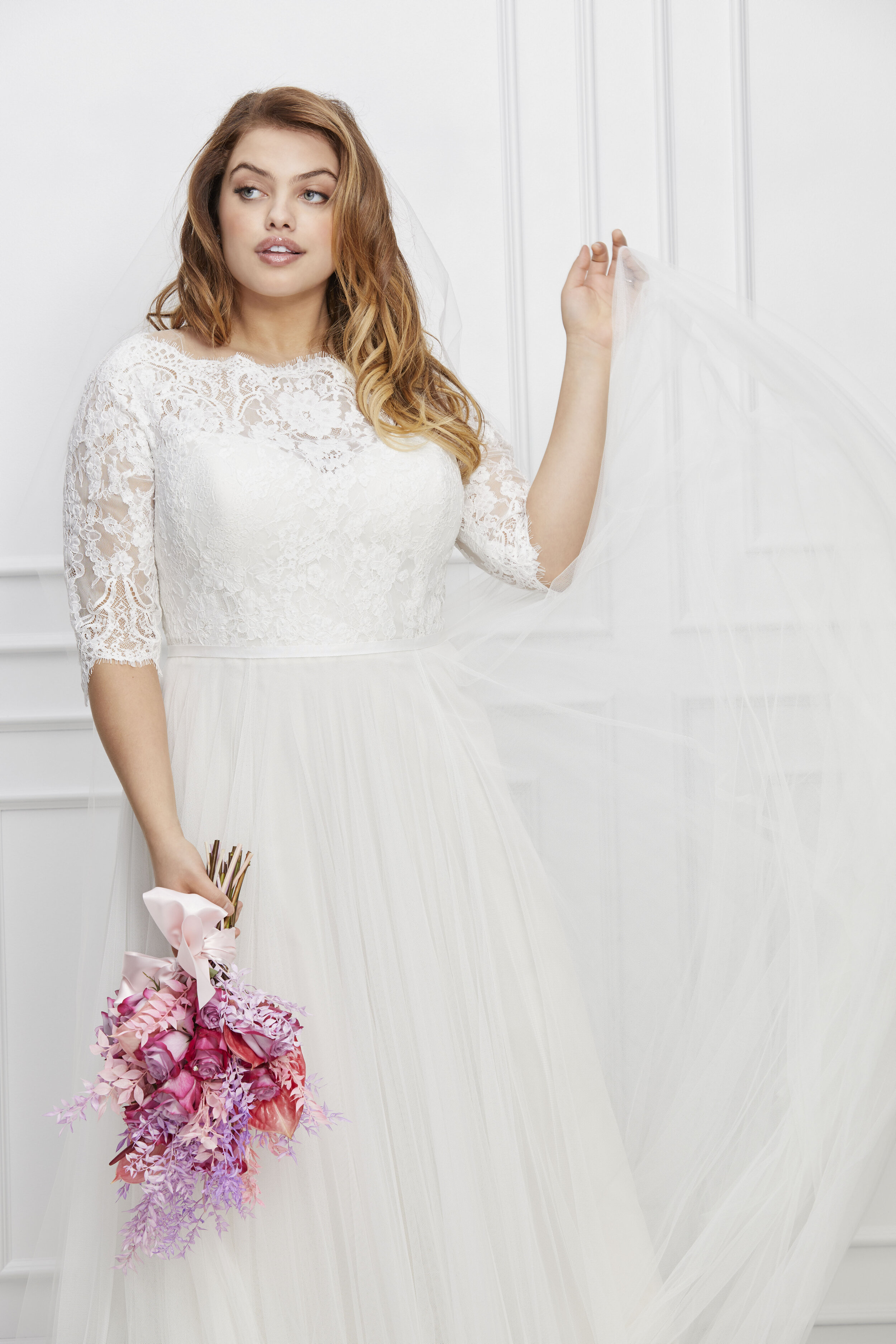 Your wedding dress should be as unique and special as your magical wedding day, now plus size brides can look no further than our designers plus size wedding dress collections. From classic lace wedding gowns to sexy backless bridal gowns, our figure-flattering gown collections are designed for every bride – Exquisite details and curve-hugging silhouettes make our plus-size wedding dresses a dream, no matter your size!