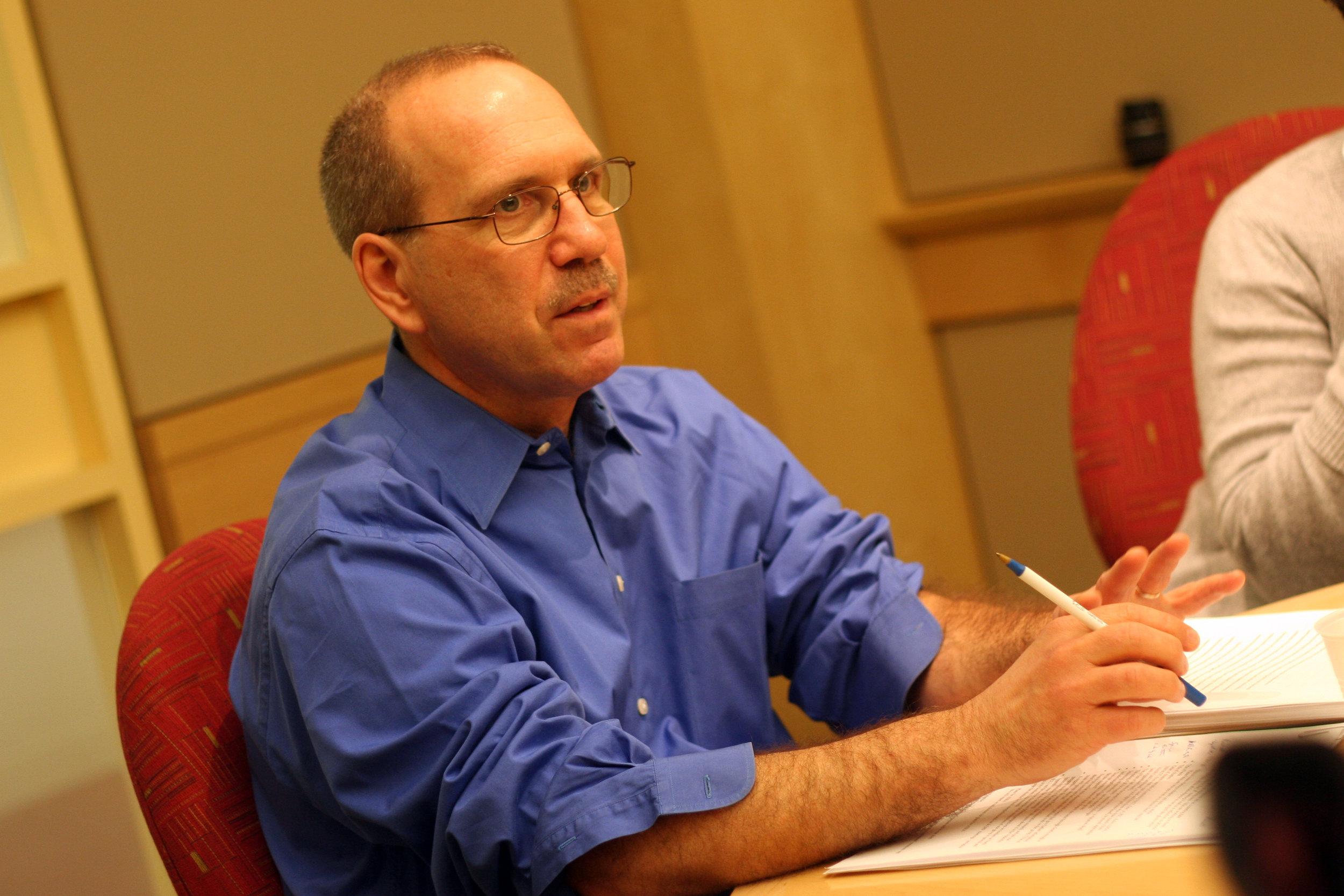 Mark at seminar table (2).JPG