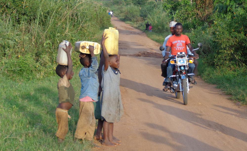 PIM-About-Kamwenge-kids-carrying-water.jpg
