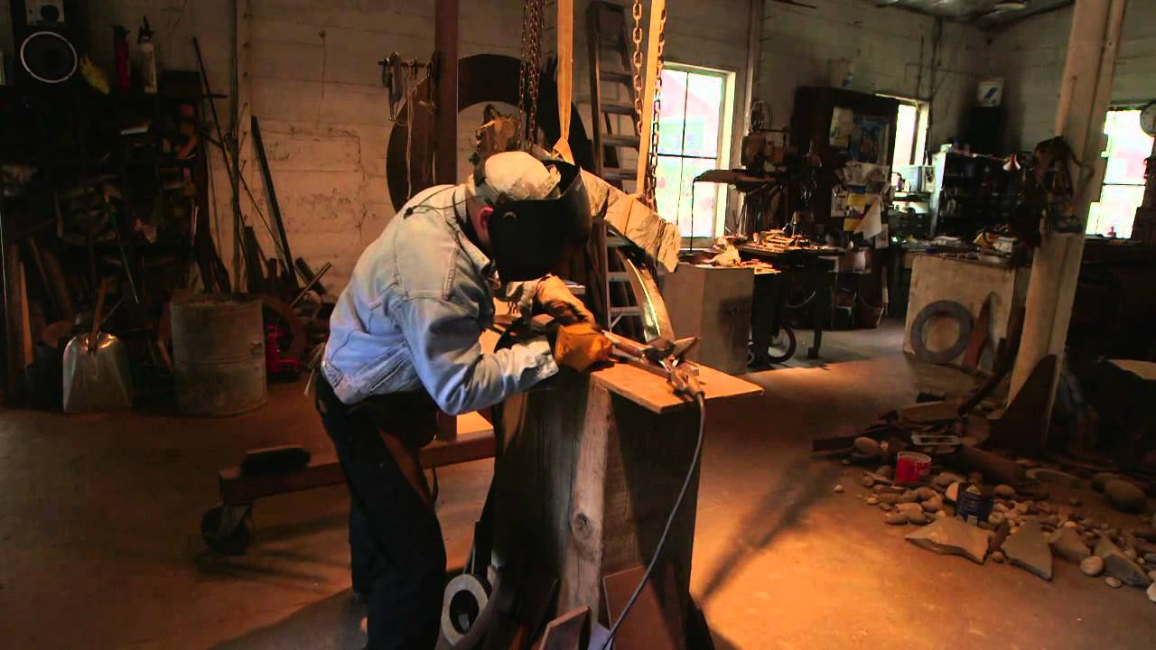 John Van Alstine welding in a still from  AHA! A House for Arts: Transcend   (youtube.com)