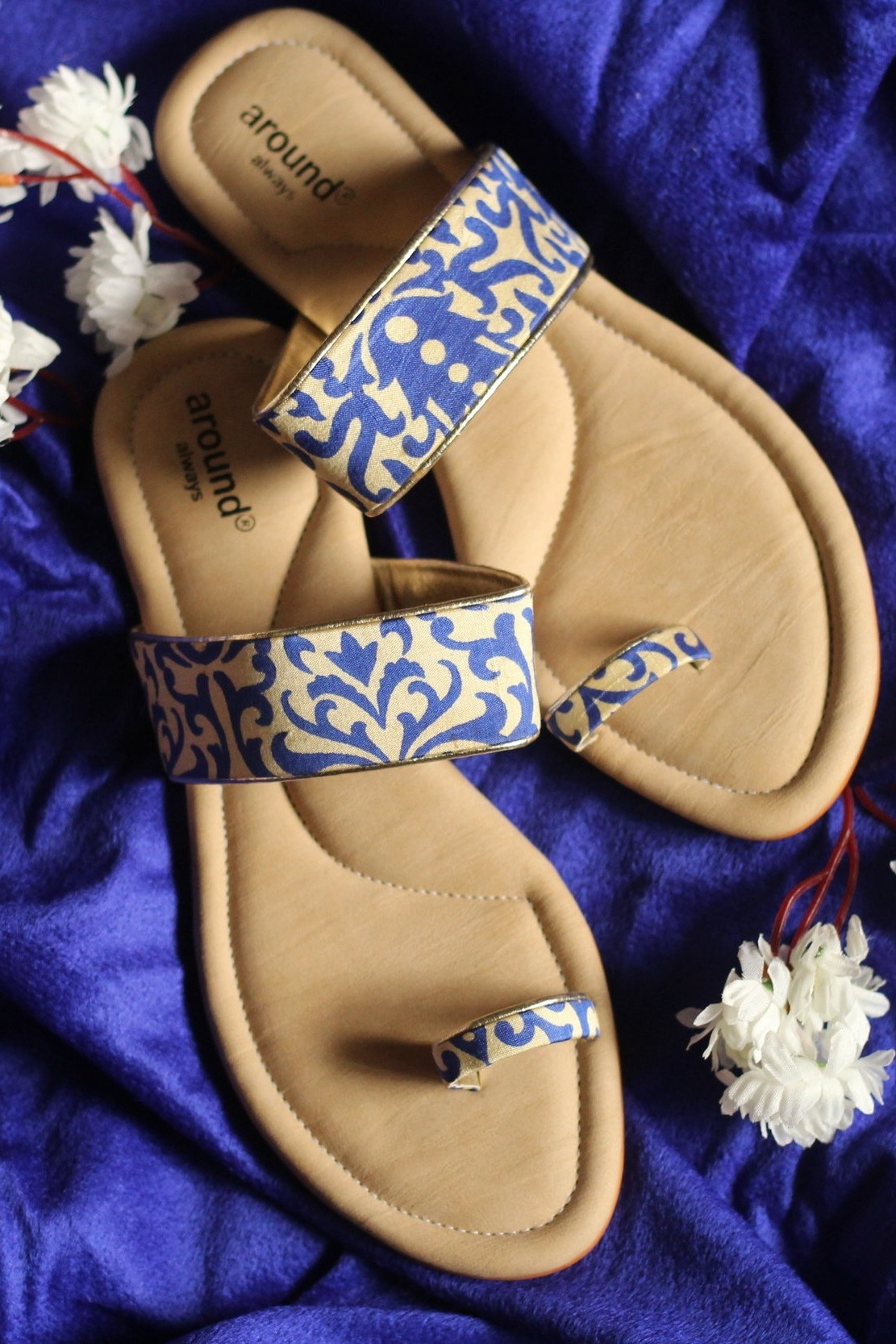 Chappals - With minimal embroidery, clean silhouette and slight touch of metallics, these chappals are perfect for all occassions.