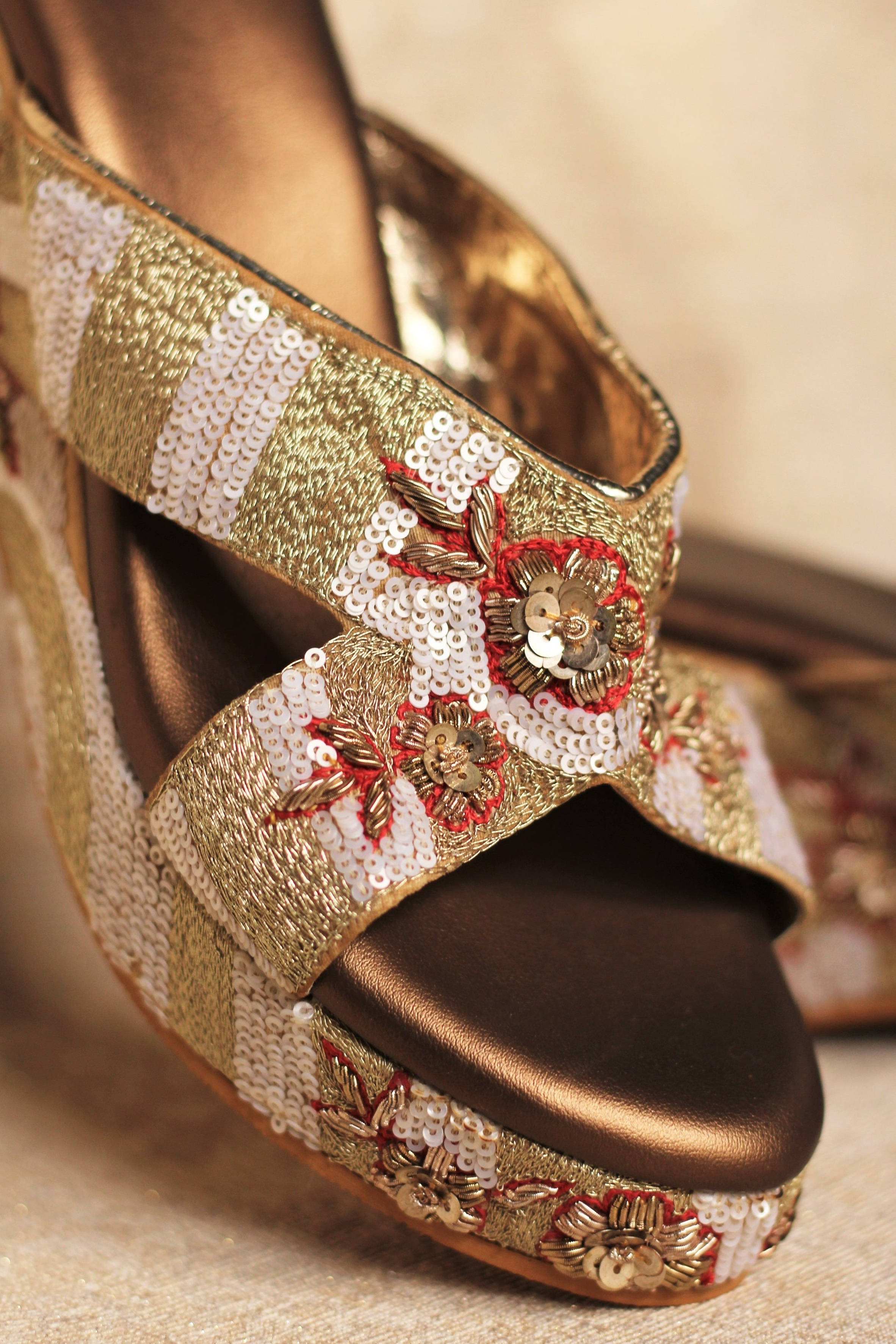 Wedges - Keeping in mind the Indian wedding which moves from moonlight to daylight we have designed the wedges to provide superior comfort, with a mixture of lavish details and intricate craftsmanship.