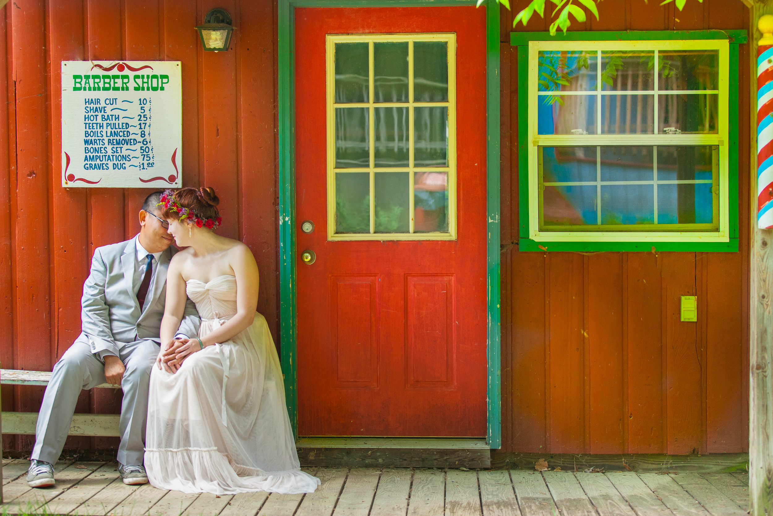Bride & groom in front of red wall