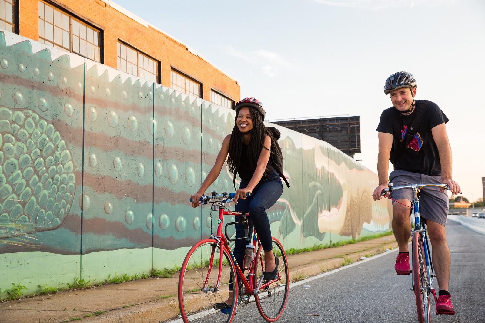 Man & woman biking in Baltimore