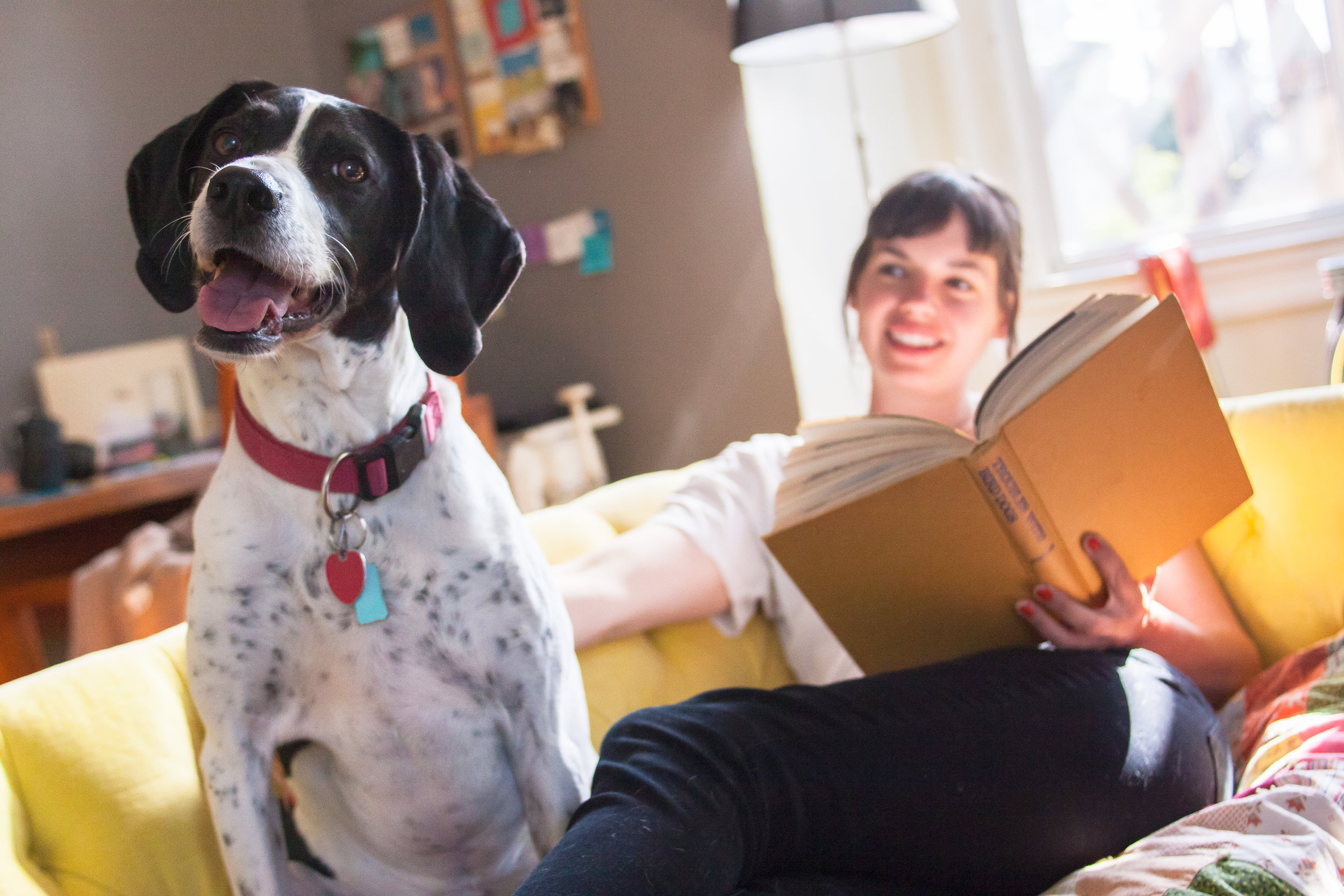 Young woman on couch with dog