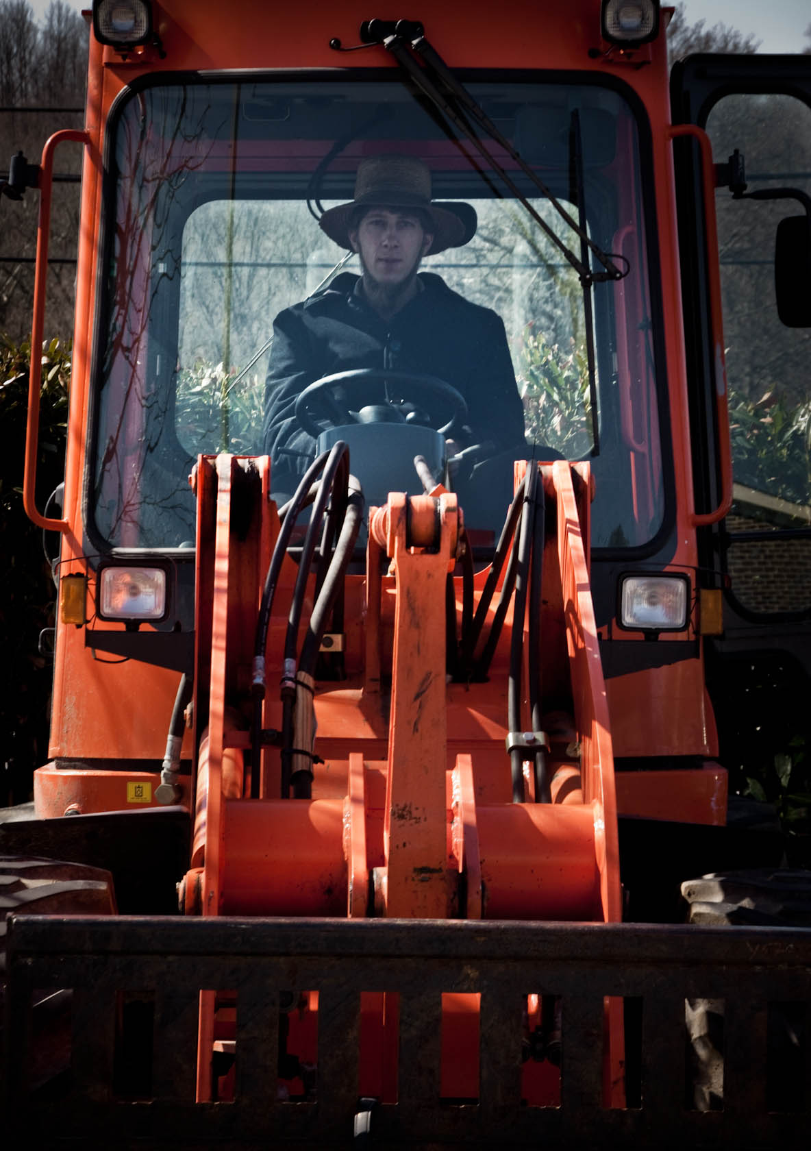 Man in red tractor