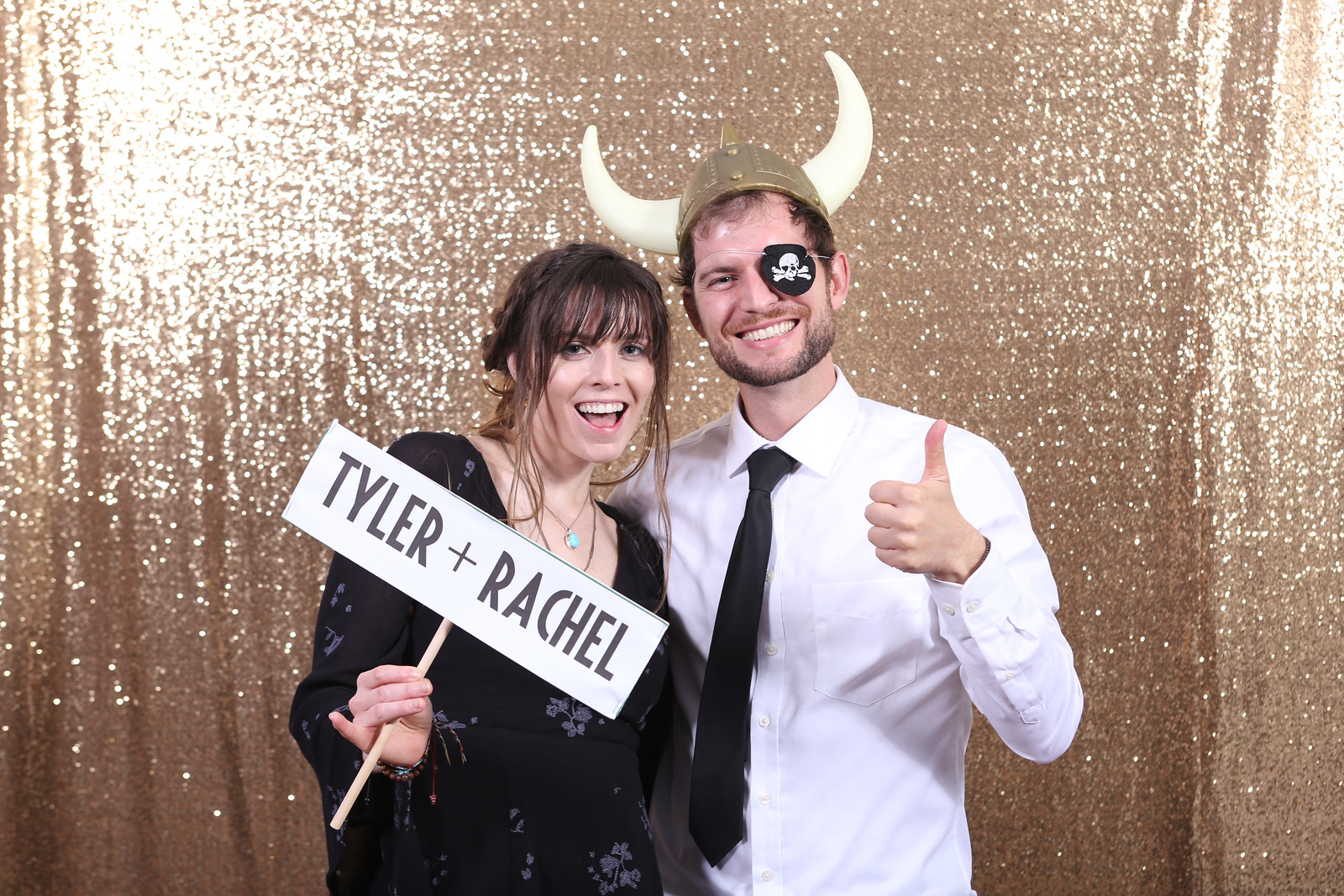 Couple in front of gold backdrop