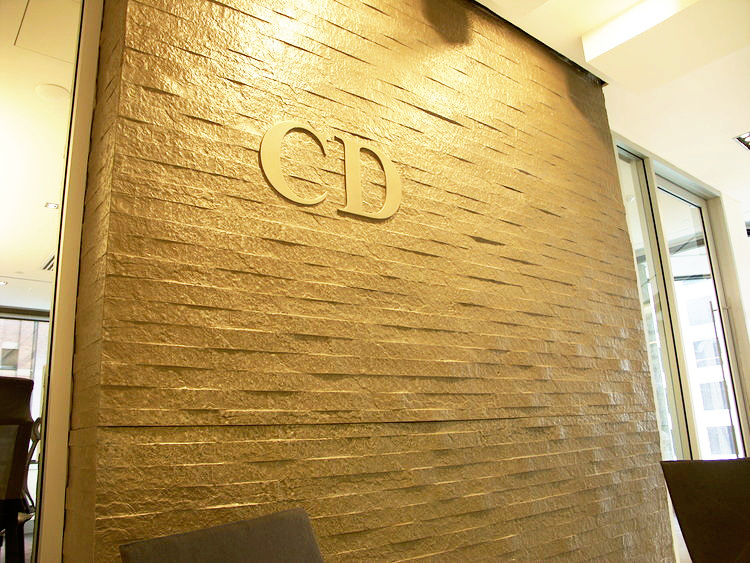 Gold wall in dior office