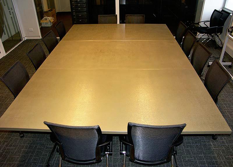 boardroom table in liqmet brass